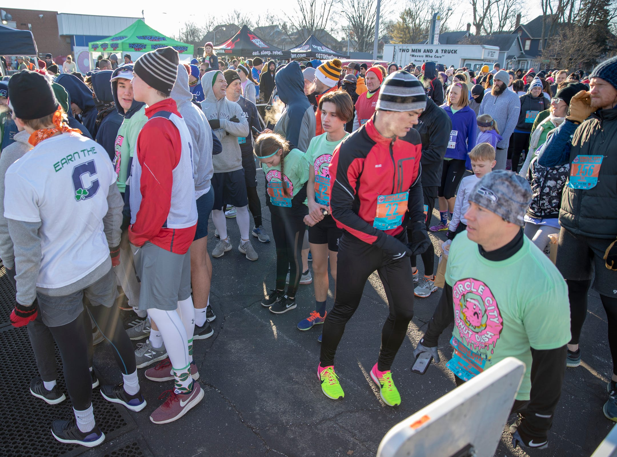 The staring area of the Circle City Donut Dash 5k, a five kilometer race that benefits Teachers' Treasures, Indianapolis, Saturday, Feb. 16, 2019. The race invites willing runners to eat a dozen doughnut holes at the halfway point in the event that helps provide school supplies for area school kids.