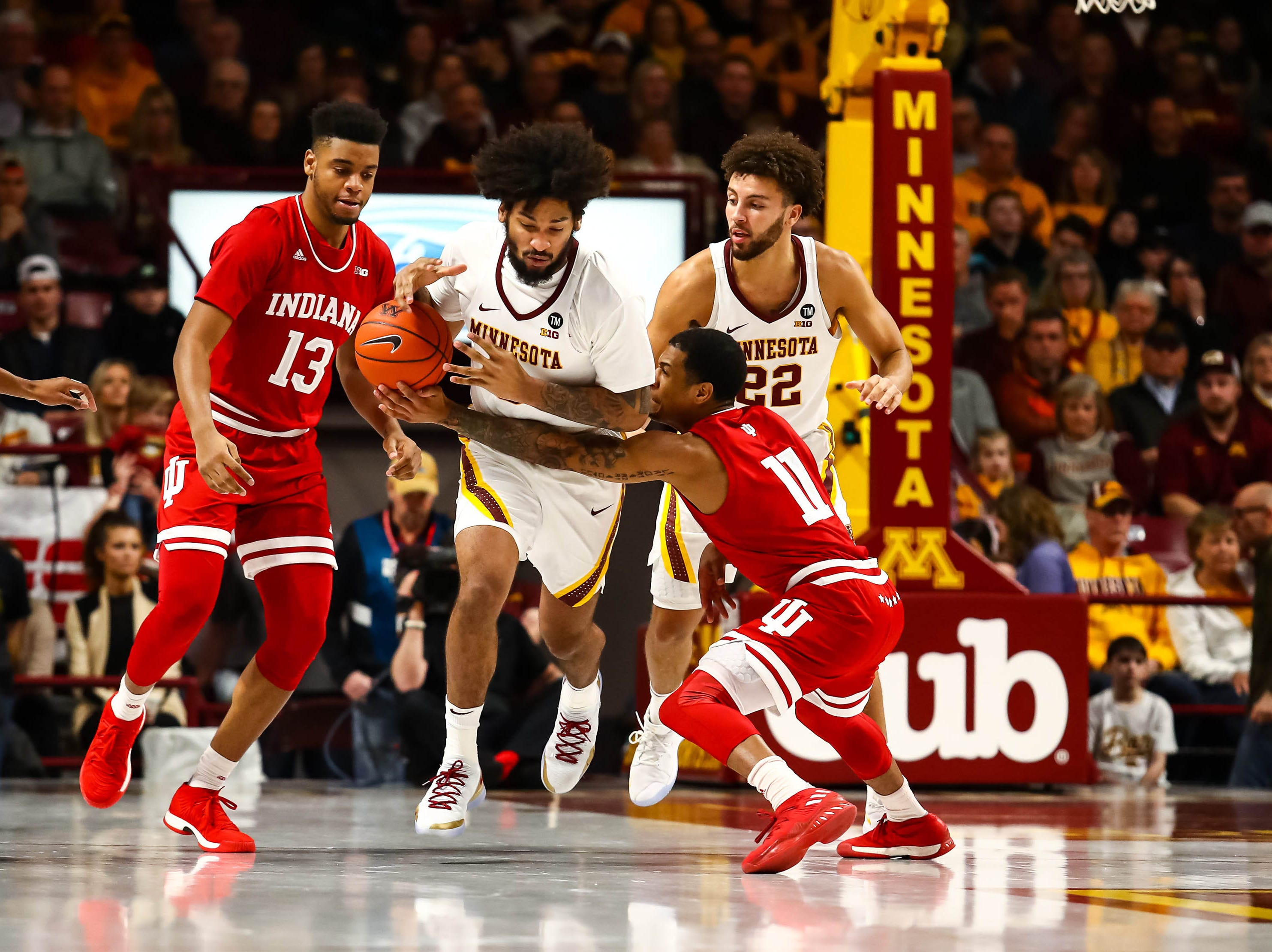 Minnesota Golden Gophers forward Jordan Murphy (3) and Indiana Hoosiers guard Devonte Green (11) chase after a loose ball in the first half at Williams Arena.
