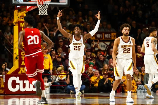 Feb 16, 2019; Minneapolis, MN, USA; Minnesota Golden Gophers center Daniel Oturu (25) reacts after hitting a three point shot in the first half against the Indiana Hoosiers at Williams Arena. Mandatory Credit: David Berding-USA TODAY Sports