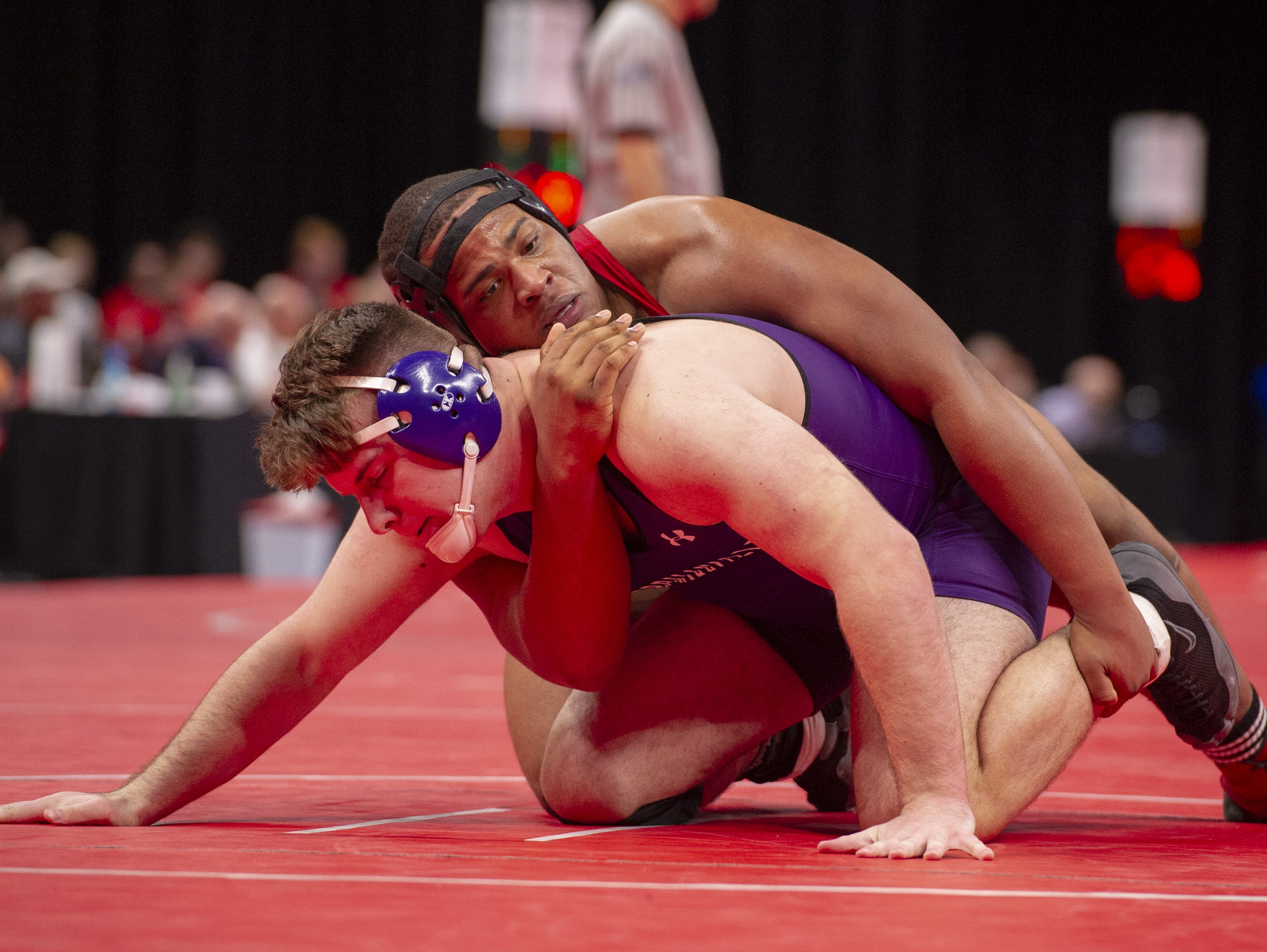 North Central High School wrestler Jamichael Watts, top, wrestles Merrillville High School wrestler Anthony Atria in the 285-pound weight class during the first day of competition in the 81st Annual IHSAA Wrestling State Finals at Bankers Life Fieldhouse in Indianapolis, Friday, Feb. 15, 2019.
