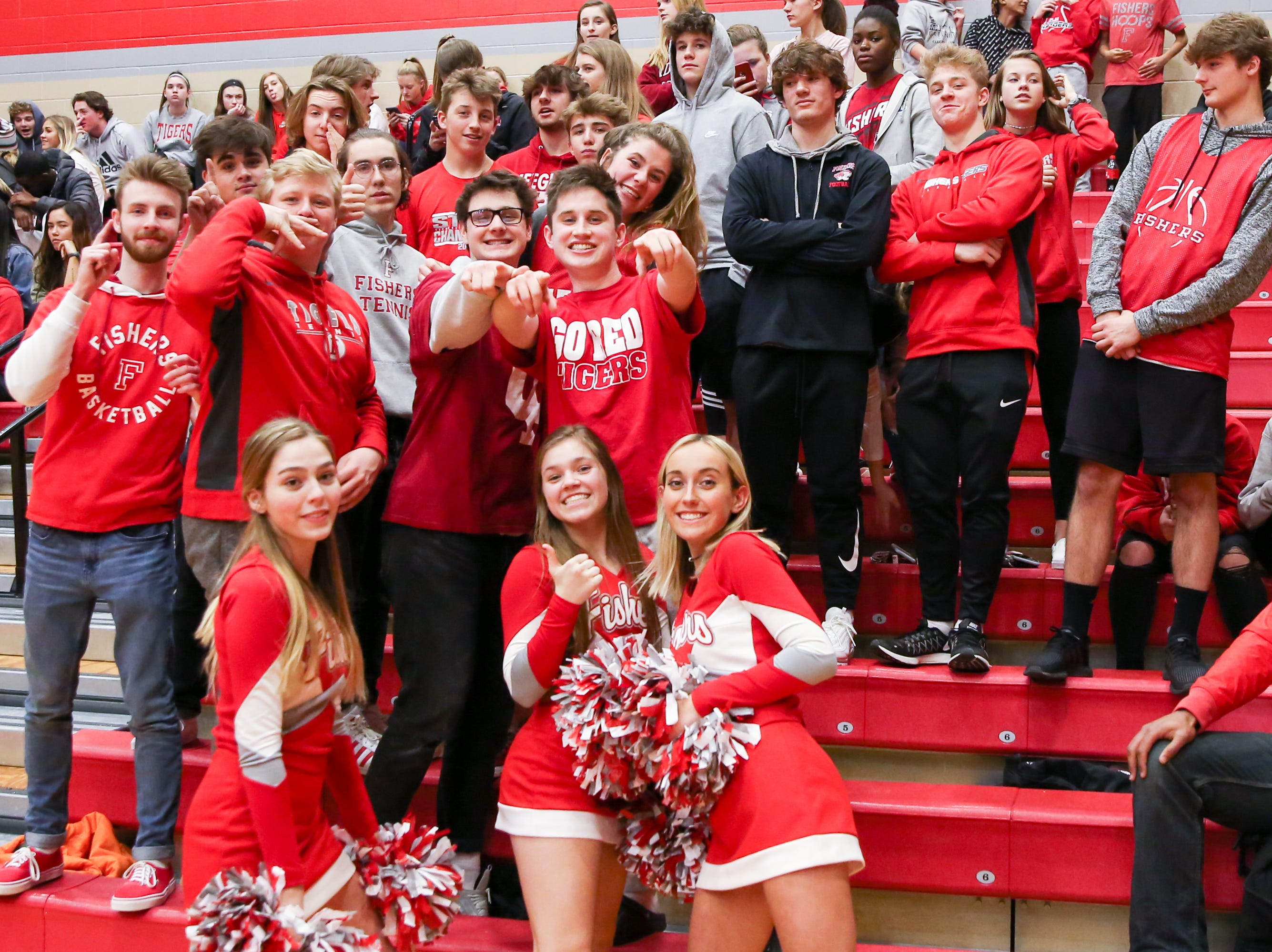 The Fisher student cheer section kept their team spirit high during the second half of Zionsville vs. Fishers high school boys varsity basketball game held at Fishers High School, February 15, 2019.