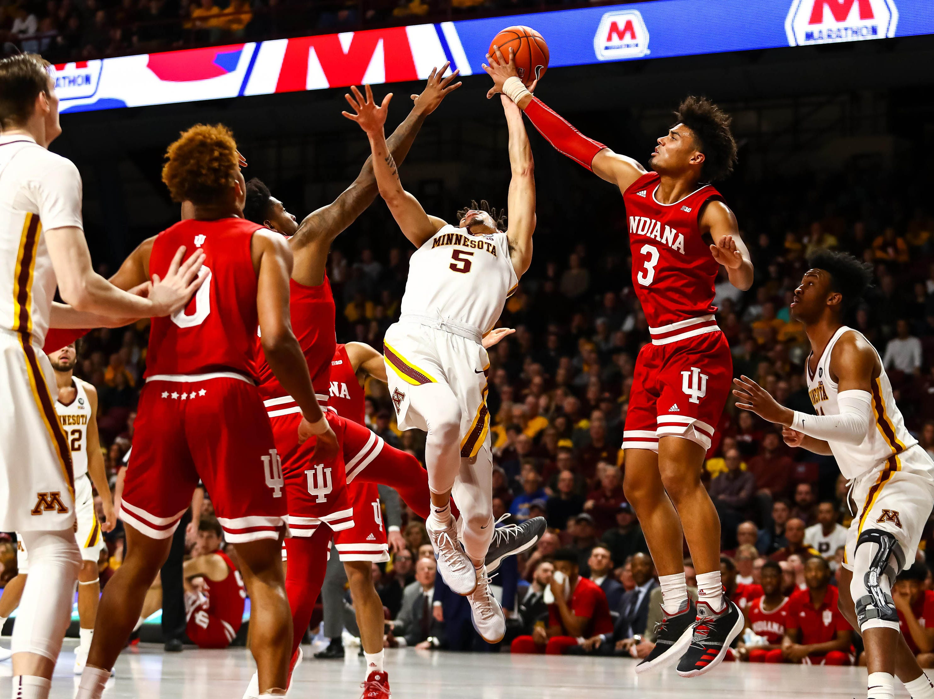 Minnesota Golden Gophers guard Amir Coffey (5) is fouled against the Indiana Hoosiers in the first half at Williams Arena.