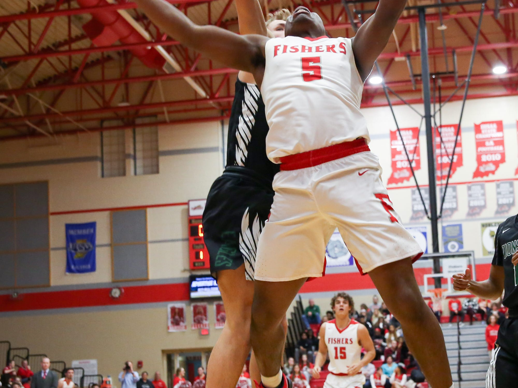 Fisher's Willie Jackson (5) takes the ball up for a shot during the first half of Zionsville vs. Fishers high school boys varsity basketball game held at Fishers High School, February 15, 2019.