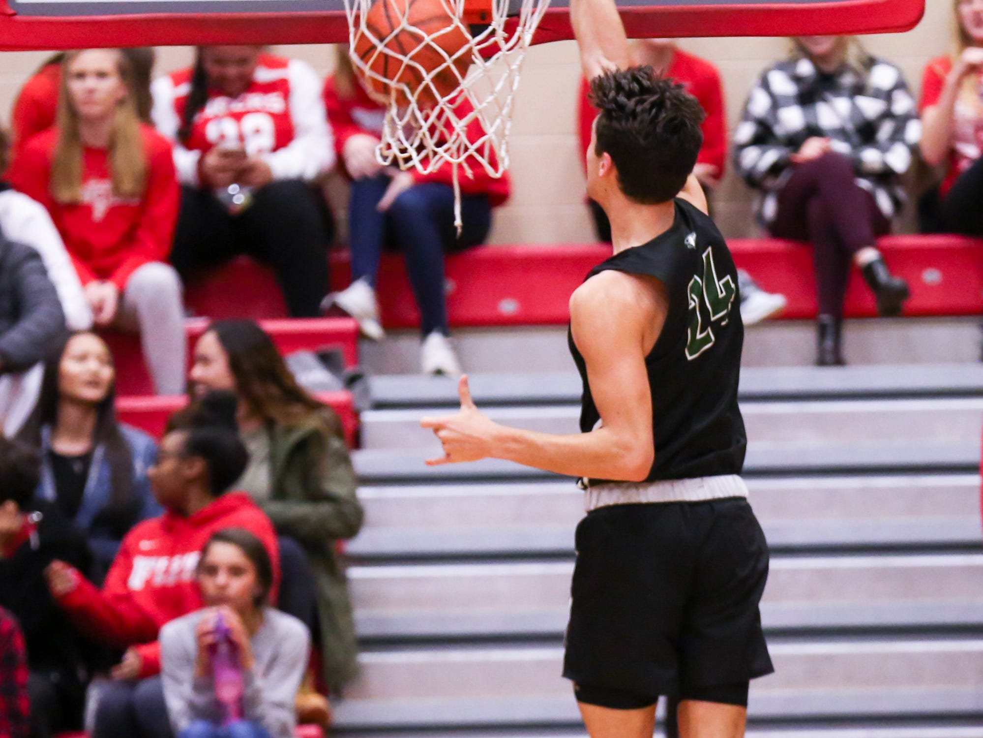 Zionsville Nathan Childress (24) in for a slam dunk during the first half of Zionsville vs. Fishers high school boys varsity basketball game held at Fishers High School, February 15, 2019.