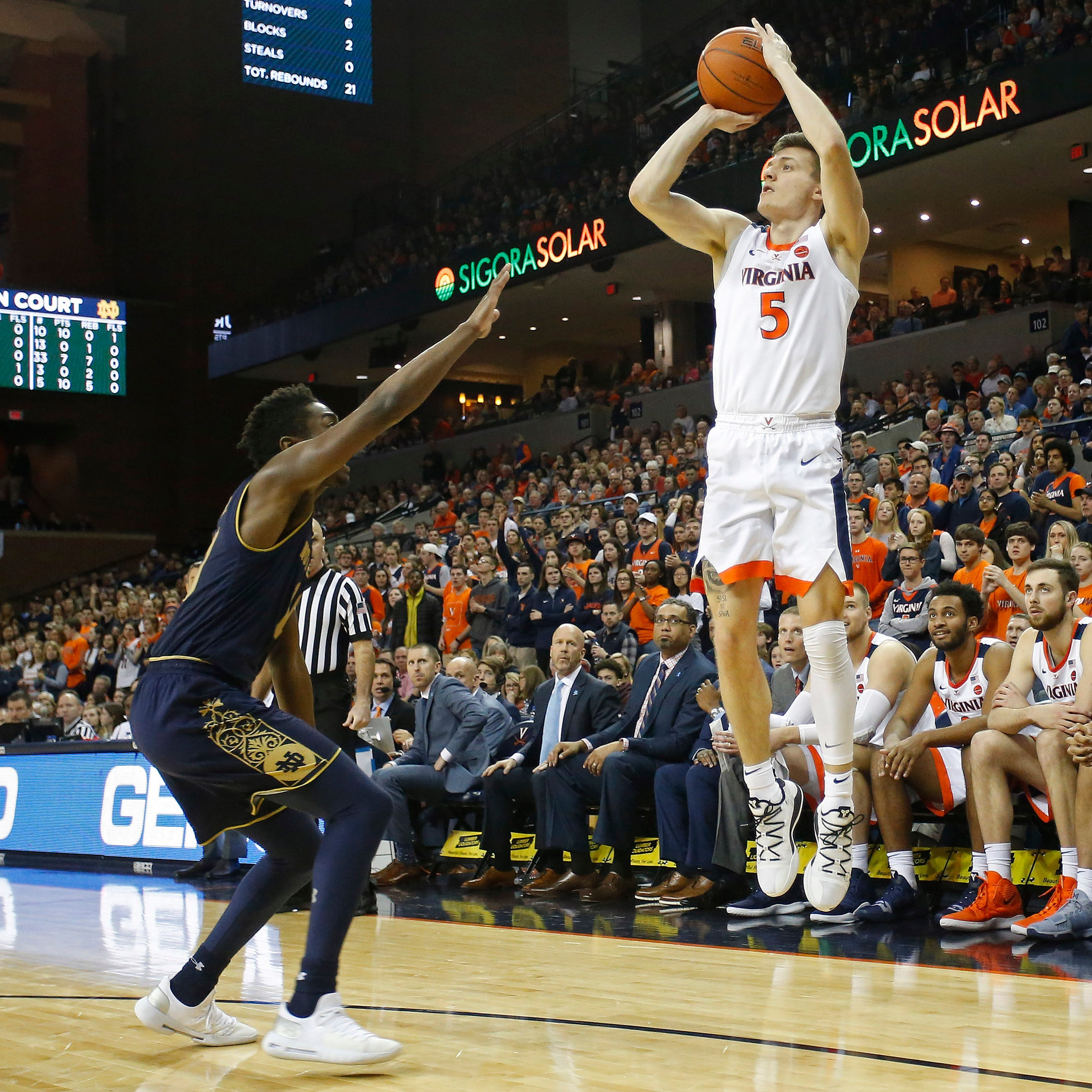 Virginia Cavaliers guard Kyle Guy (5) shoots the ball over Notre Dame Fighting Irish guard TJ Gibbs (10) in the second half at John Paul Jones Arena. The Cavaliers won 60-54.