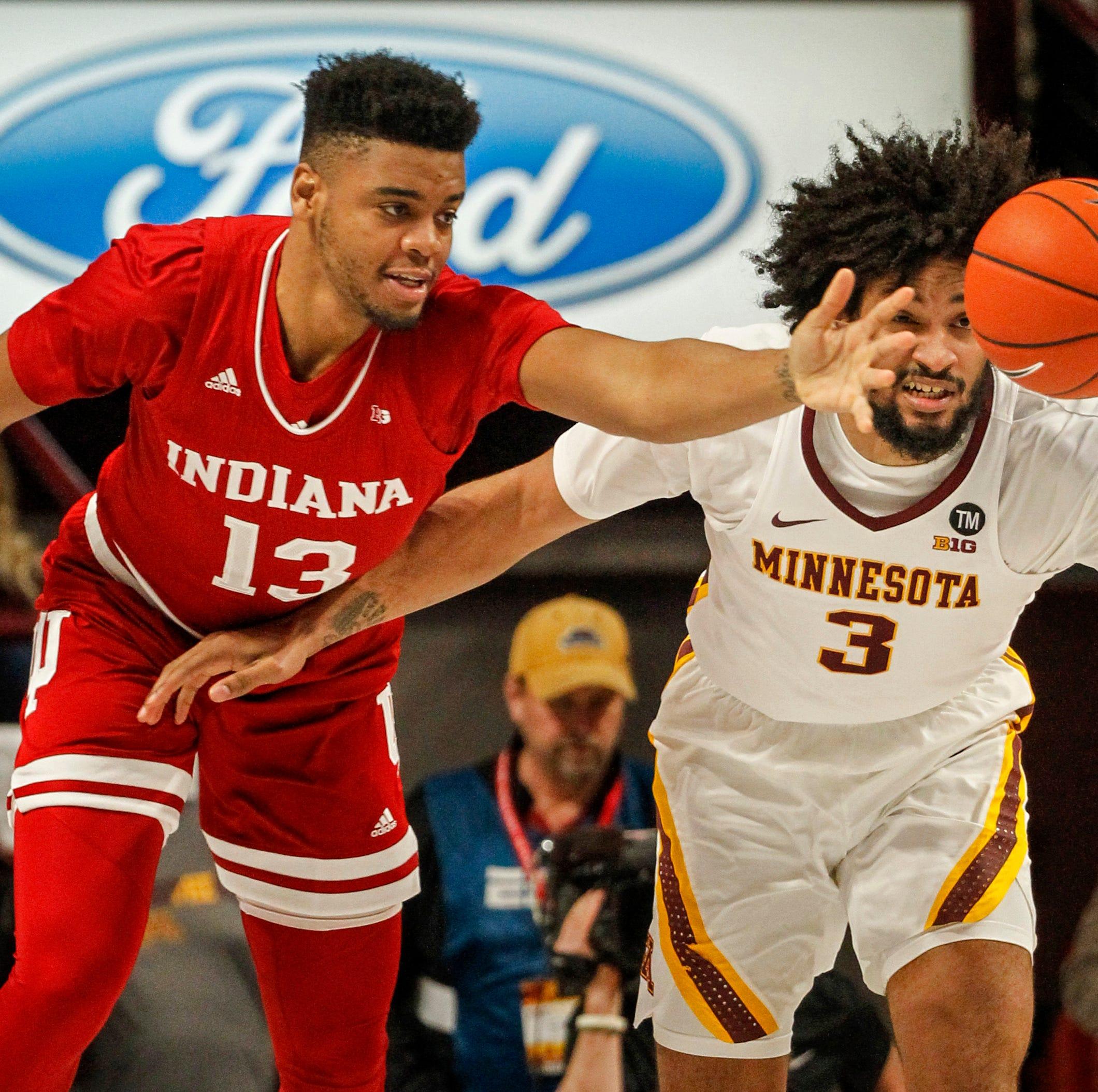 Indiana's Juwan Morgan (13) and Minnesota's...