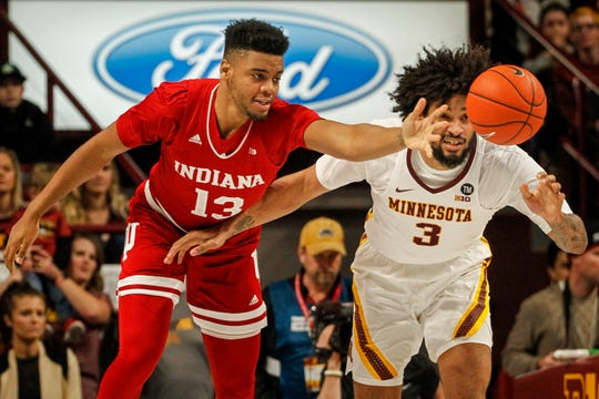 Indiana's Juwan Morgan (13) and Minnesota's Jordan Murphy (3) battle for a loose ball, Feb. 16, 2019, in Minneapolis.