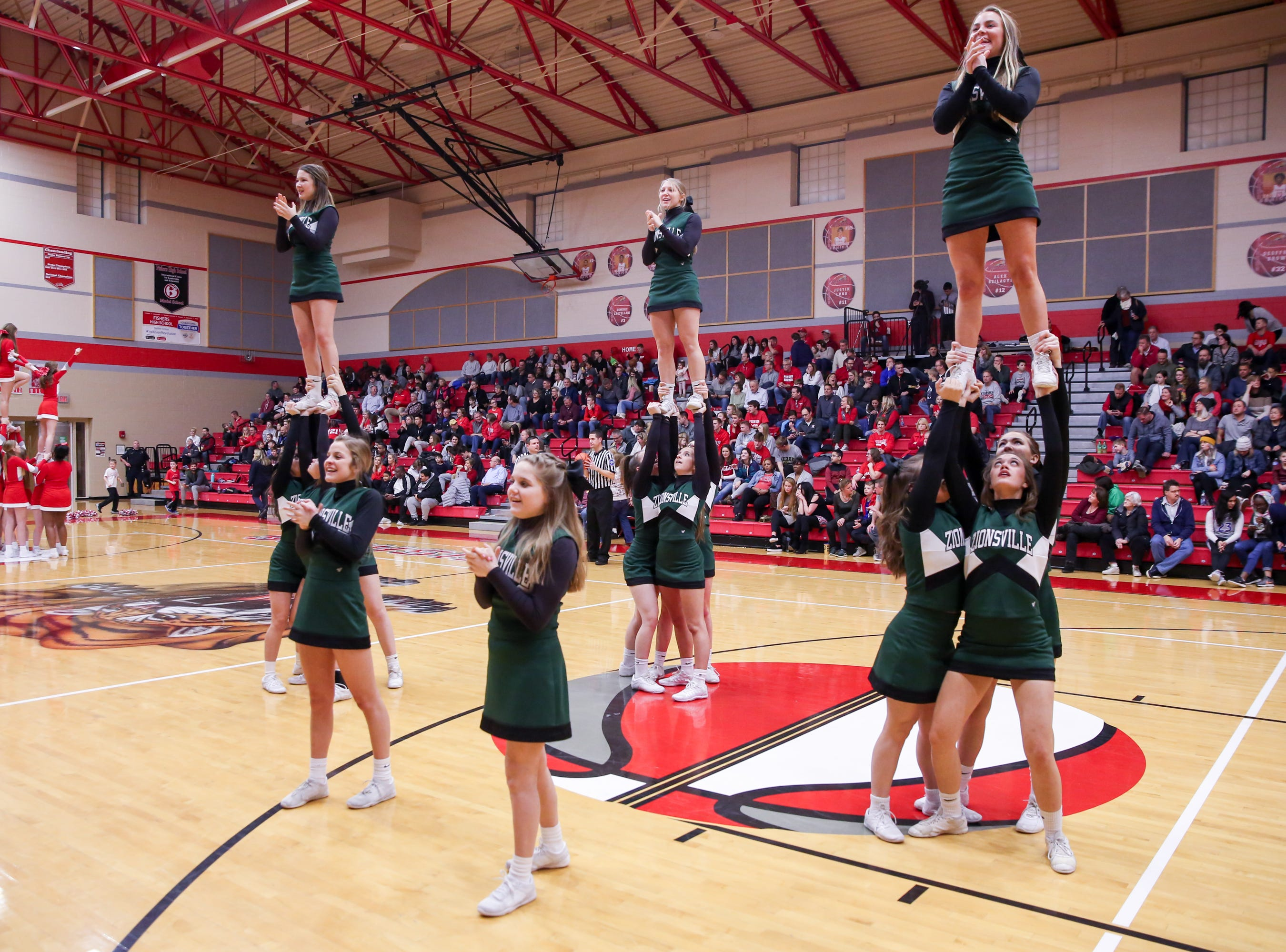 Zionsville cheerleaders rally the crowd during the second half of Zionsville vs. Fishers high school boys varsity basketball game held at Fishers High School, February 15, 2019.