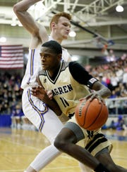 Warren Central's Jesse Bingham (11) and Carmel's  John Michael Mulloy earned All-MIC honors this season.