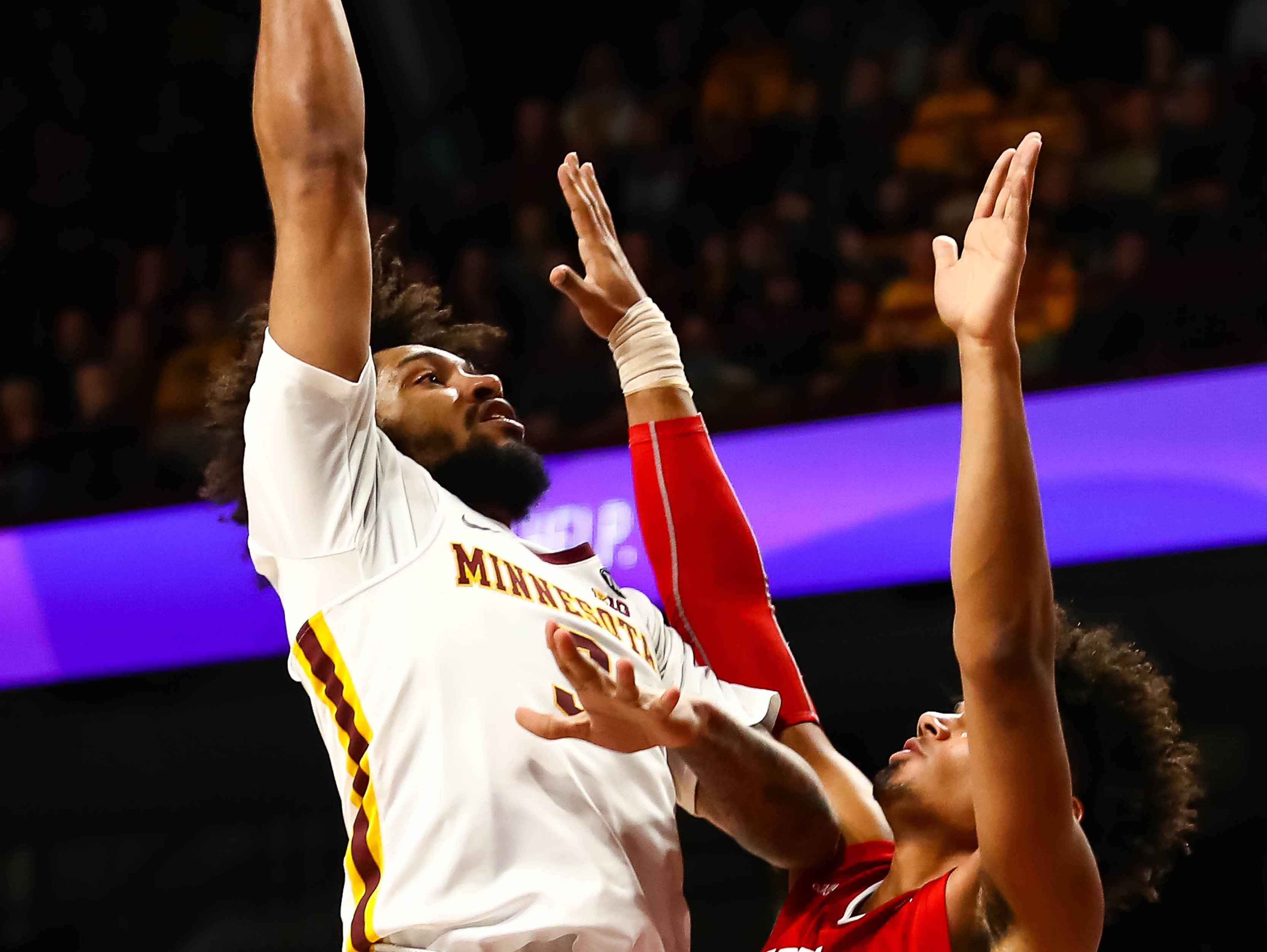 Minnesota Golden Gophers forward Jordan Murphy (3) goes up for a shot while Indiana Hoosiers forward Justin Smith (3) defends in the first half at Williams Arena.