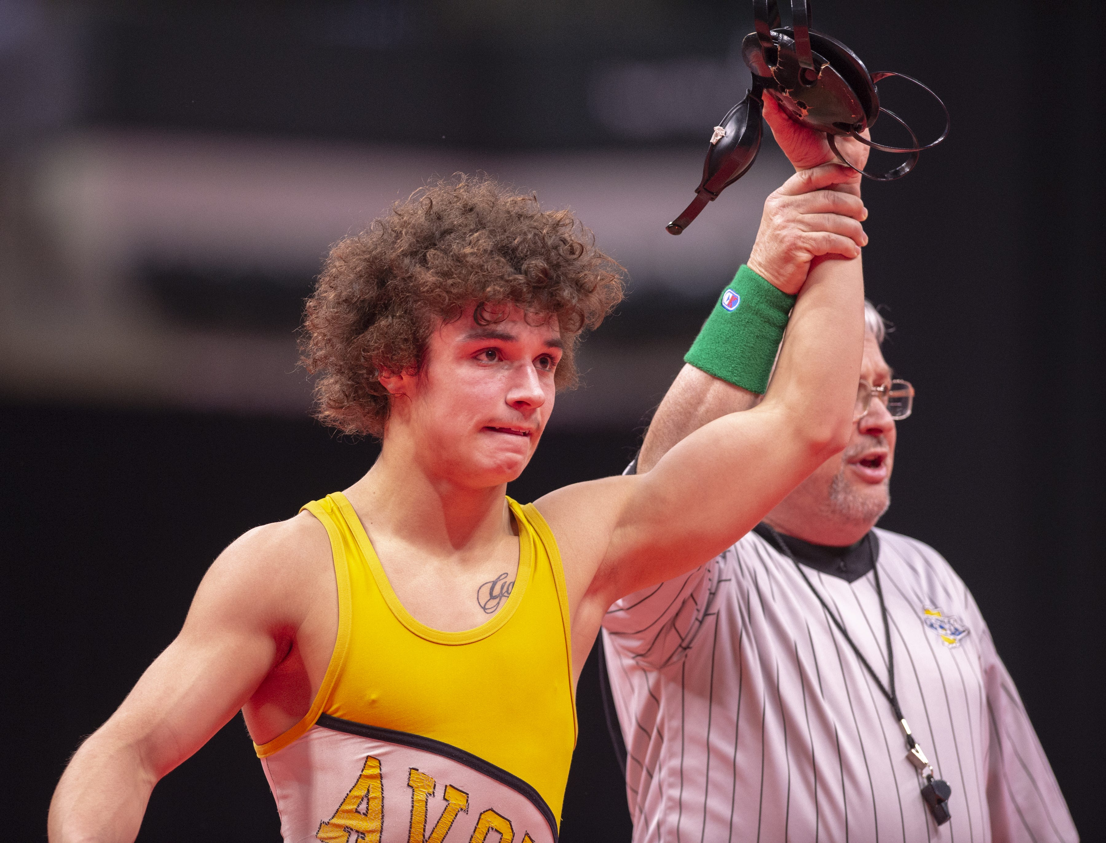 Avon High School wrestler Asa Garcia defeated Rensselaer Central High School wrestler Elijah Hickman in the 132-pound weight class during the first day of competition in the 81st Annual IHSAA Wrestling State Finals at Bankers Life Fieldhouse in Indianapolis, Friday, Feb. 15, 2019.