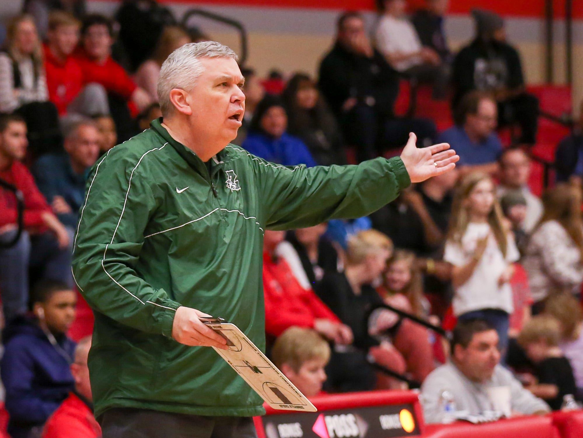 Zionsville High Coach Shaun Busick tries to focus his team as they struggle with scoring during the first half of Zionsville vs. Fishers high school boys varsity basketball game held at Fishers High School, February 15, 2019.