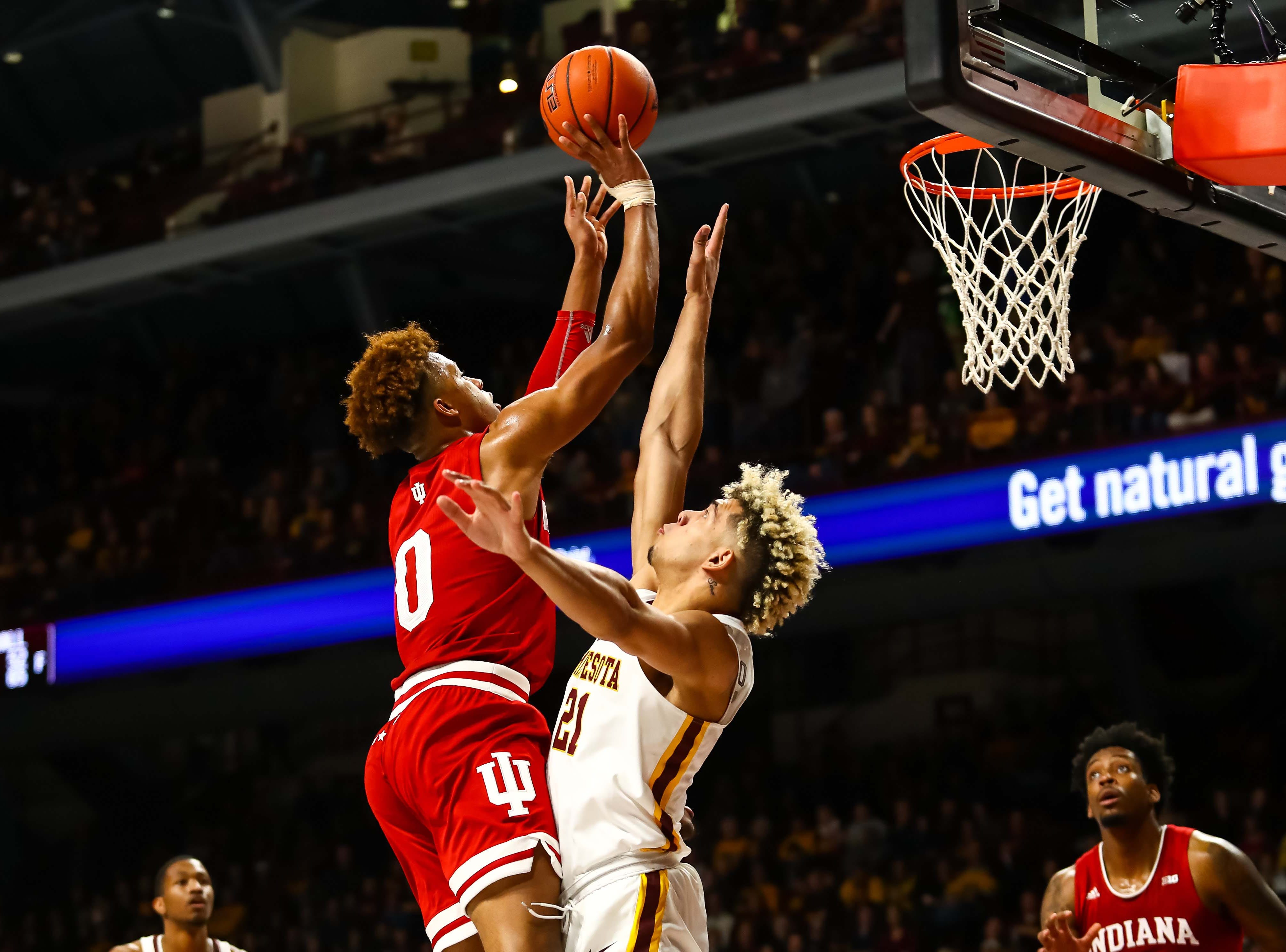 Feb 16, 2019; Minneapolis, MN, USA; Indiana Hoosiers guard Romeo Langford (0) goes up for a shot while Minnesota Golden Gophers forward Jarvis Omersa (21) defends in the second half at Williams Arena. The Minnesota Golden Gophers defeatd the Indiana Hoosiers 84-63. Mandatory Credit: David Berding-USA TODAY Sports