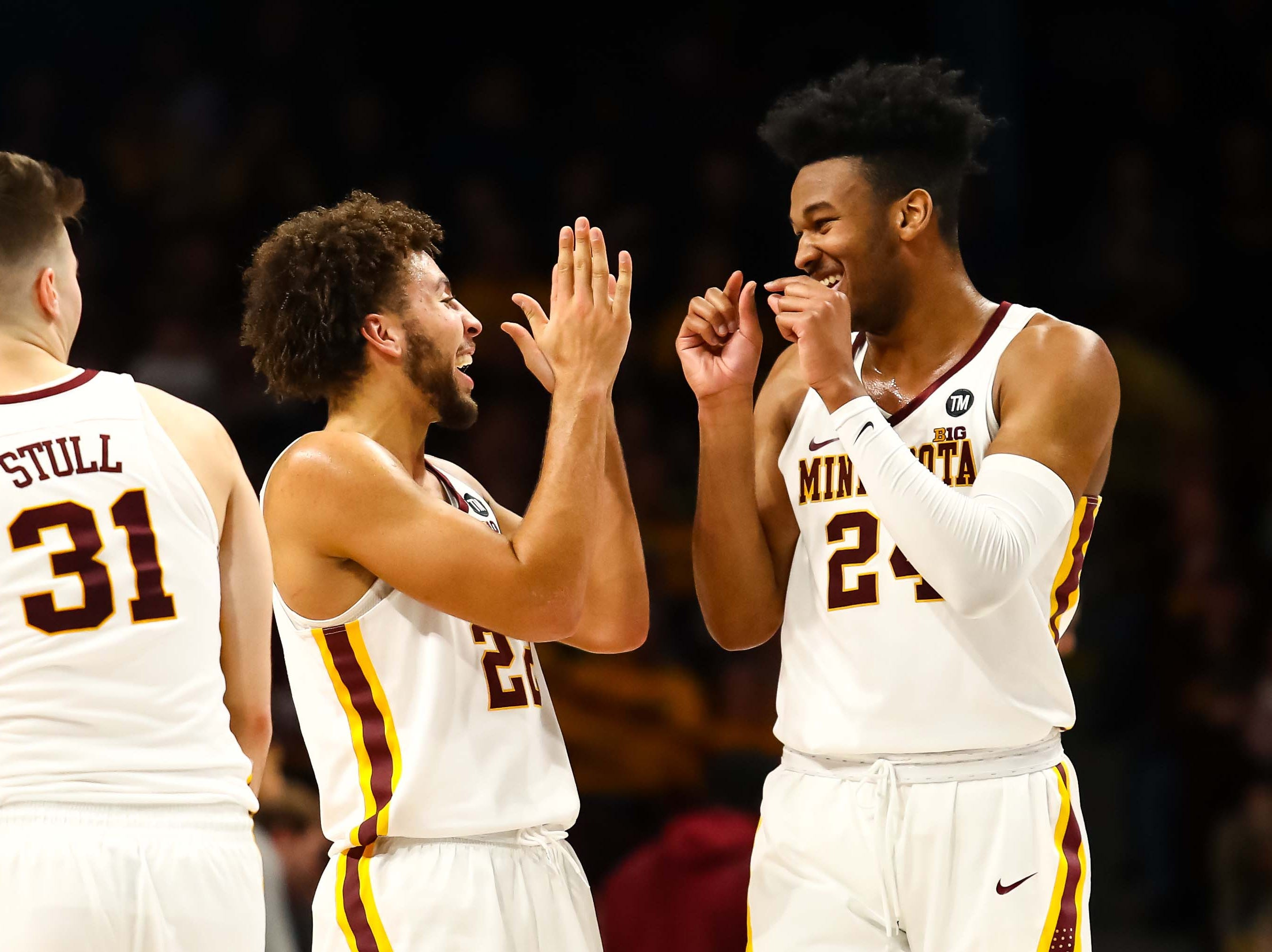 Minnesota Golden Gophers guard Gabe Kalscheur (22) and forward Eric Curry (24) laugh in the second half against the Indiana Hoosiers at Williams Arena. The Minnesota Golden Gophers defeatd the Indiana Hoosiers 84-63.