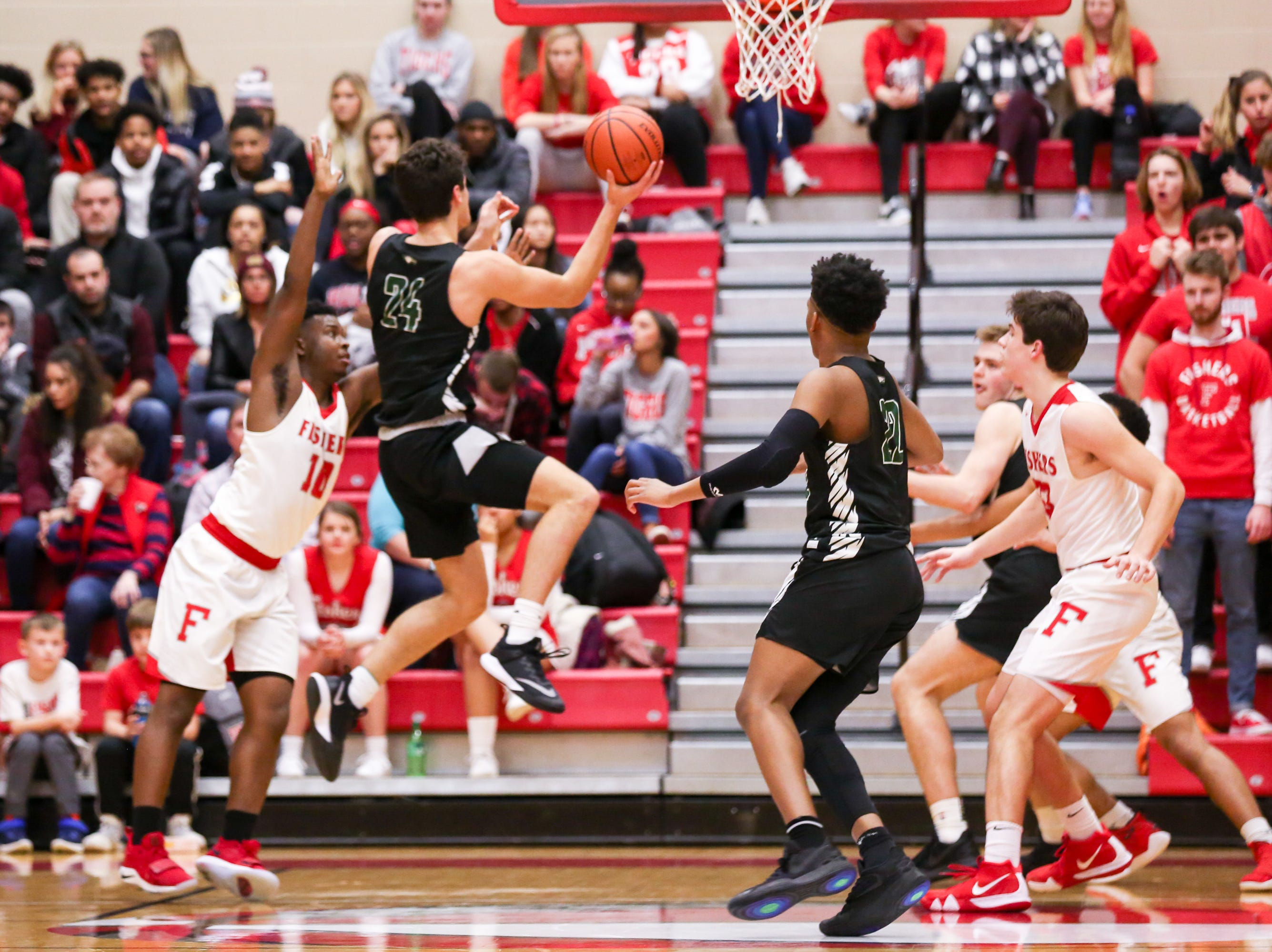 Zionsville Nathan Childress (24) with the short jump shot during the first half of Zionsville vs. Fishers high school boys varsity basketball game held at Fishers High School, February 15, 2019.