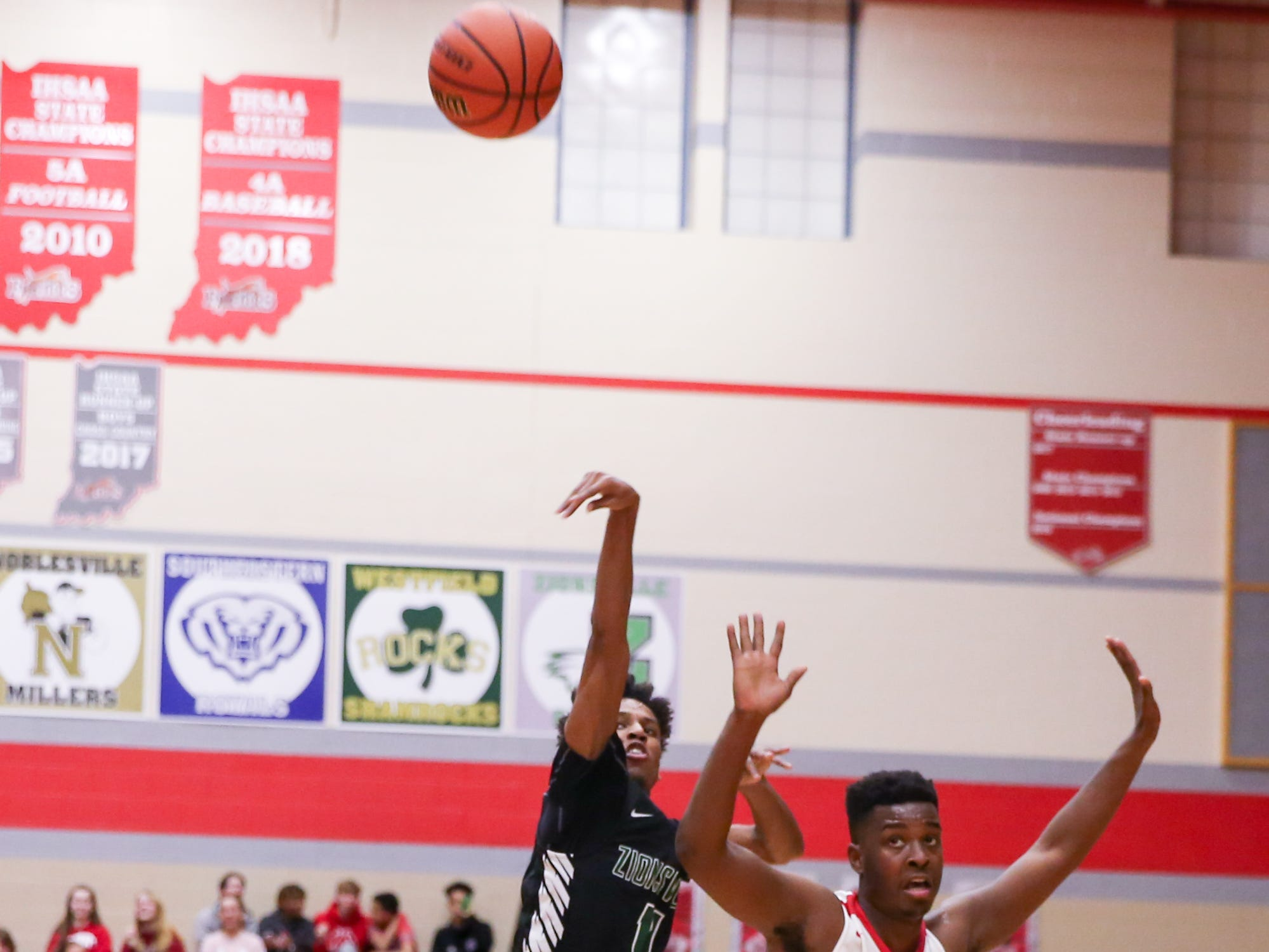 Zionsville Isaiah Thompson (11) with the 3 point shot during the second half of Zionsville vs. Fishers high school boys varsity basketball game held at Fishers High School, February 15, 2019.