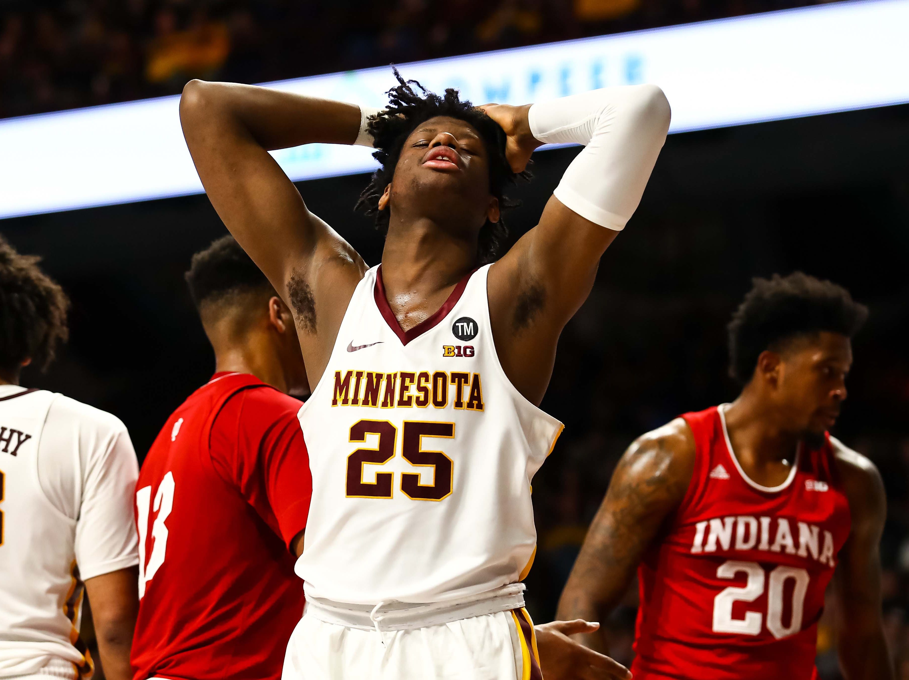 Feb 16, 2019; Minneapolis, MN, USA; Minnesota Golden Gophers center Daniel Oturu (25) reacts after getting called for a foul against the Indiana Hoosiers in the second half at Williams Arena. The Minnesota Golden Gophers defeatd the Indiana Hoosiers 84-63. Mandatory Credit: David Berding-USA TODAY Sports