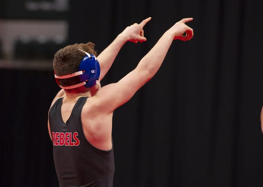 Roncalli High School wrestler Brayden Lowery celebrates his overtime victory over Avon High School wrestler Tyler Conley in the 120-pound weight class during the first day of competition in the 81st Annual IHSAA Wrestling State Finals at Bankers Life Fieldhouse in Indianapolis, Friday, Feb. 15, 2019.