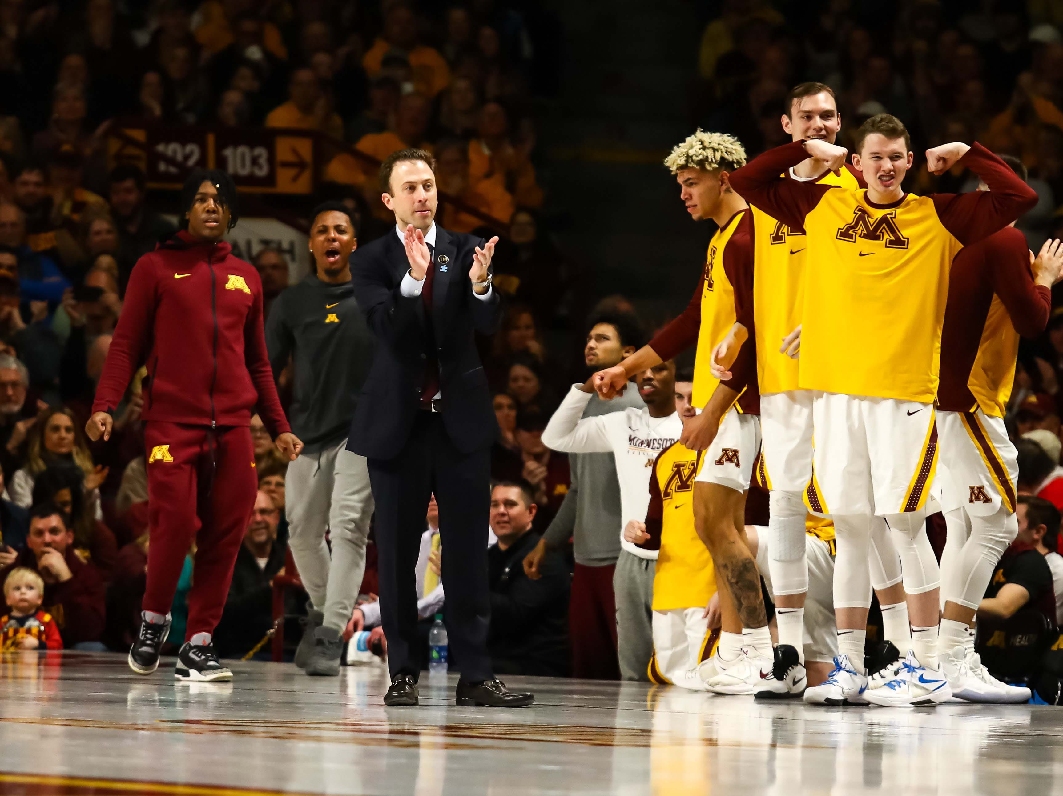 Feb 16, 2019; Minneapolis, MN, USA; Minnesota Golden Gophers head coach Richard Pitino and his players react to a play against the Indiana Hoosiers in the second half at Williams Arena. The Minnesota Golden Gophers defeatd the Indiana Hoosiers 84-63. Mandatory Credit: David Berding-USA TODAY Sports