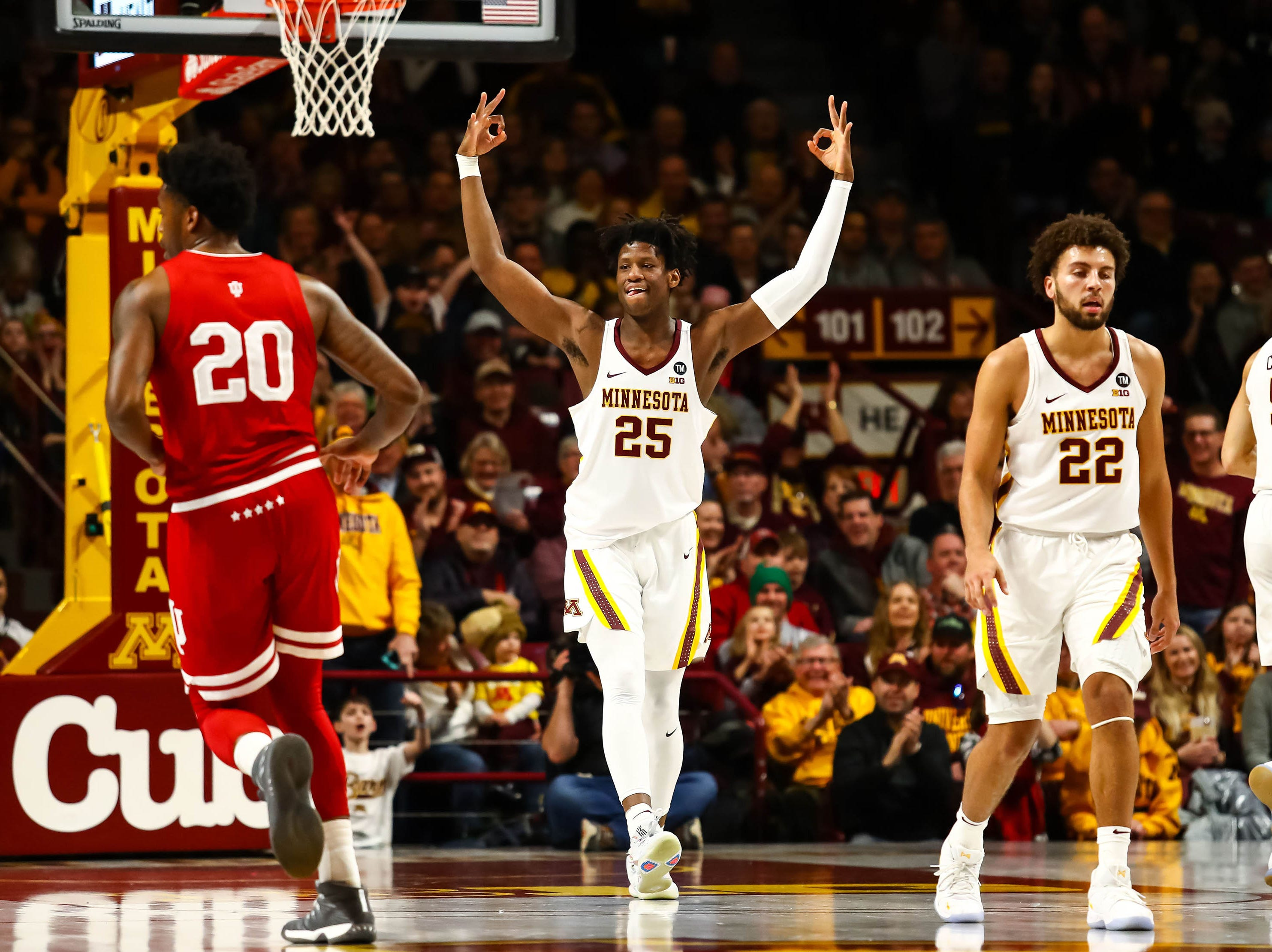 Minnesota Golden Gophers center Daniel Oturu (25) reacts after hitting a three point shot in the first half against the Indiana Hoosiers at Williams Arena.