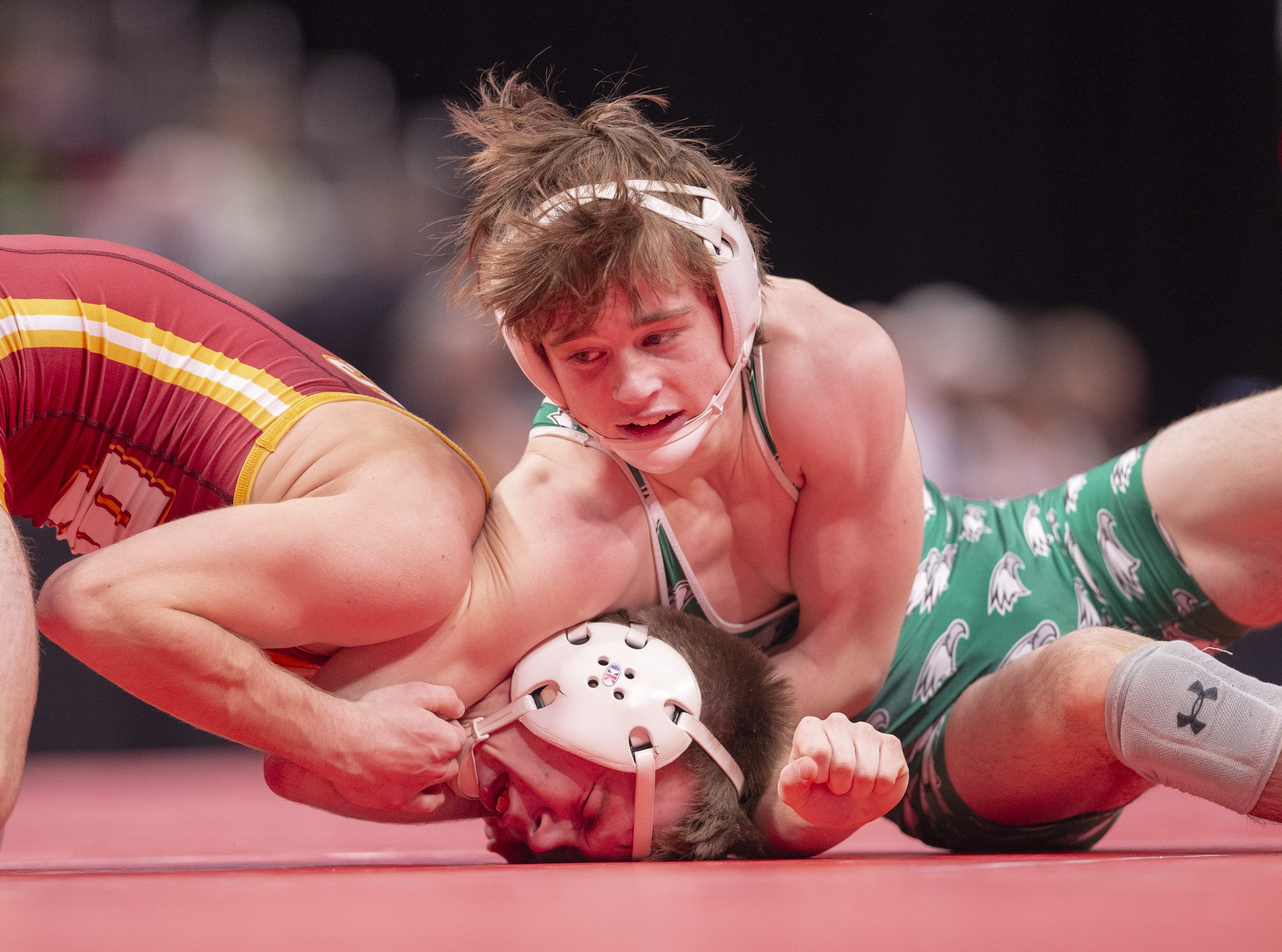 Zionsville High School wrestler Logan Wagner wrestles Evansville Mater Dei wrestler Kane Egli in the 126-pound weight class during the first day of competition in the 81st Annual IHSAA Wrestling State Finals at Bankers Life Fieldhouse in Indianapolis, Friday, Feb. 15, 2019.