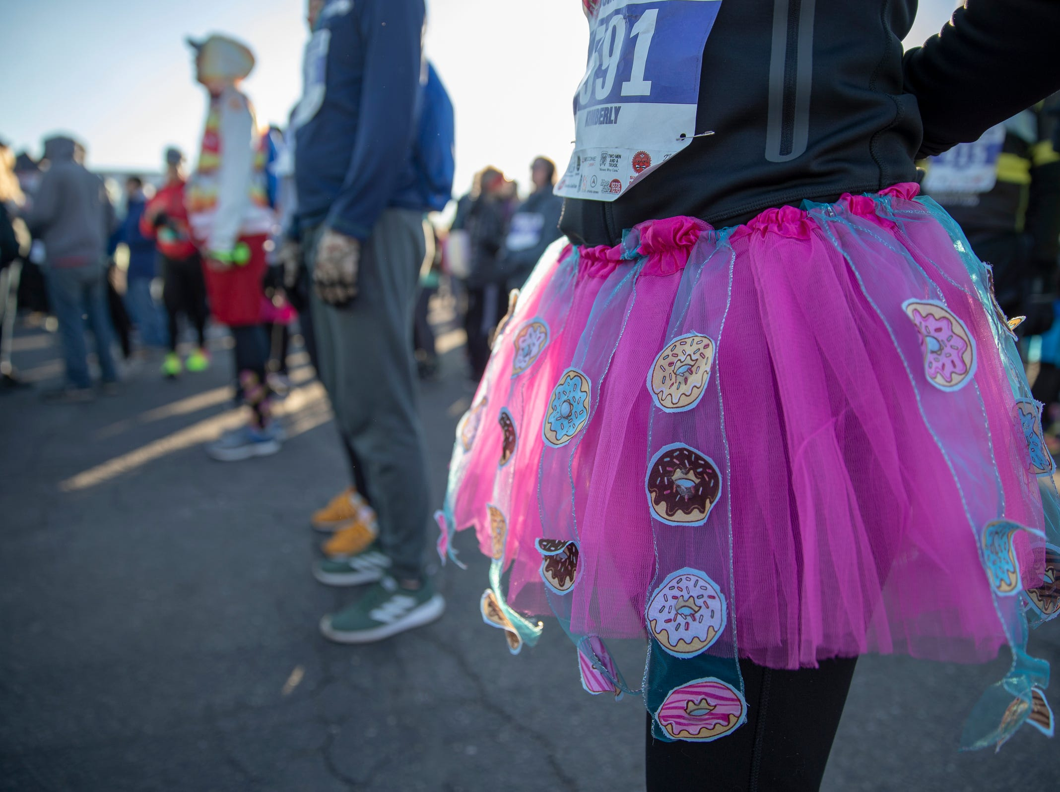 A festive skirt worn by Kim Davis, Pendleton just before the Circle City Donut Dash 5k, a five kilometer race that benefits Teachers' Treasures, Indianapolis, Saturday, Feb. 16, 2019. The race invites willing runners to eat a dozen doughnut holes at the halfway point in the event that helps provide school supplies for area school kids.