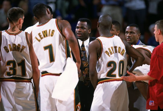 Nate McMillan (center) coached the Sonics for five seasons, compiling a 212-183 record.