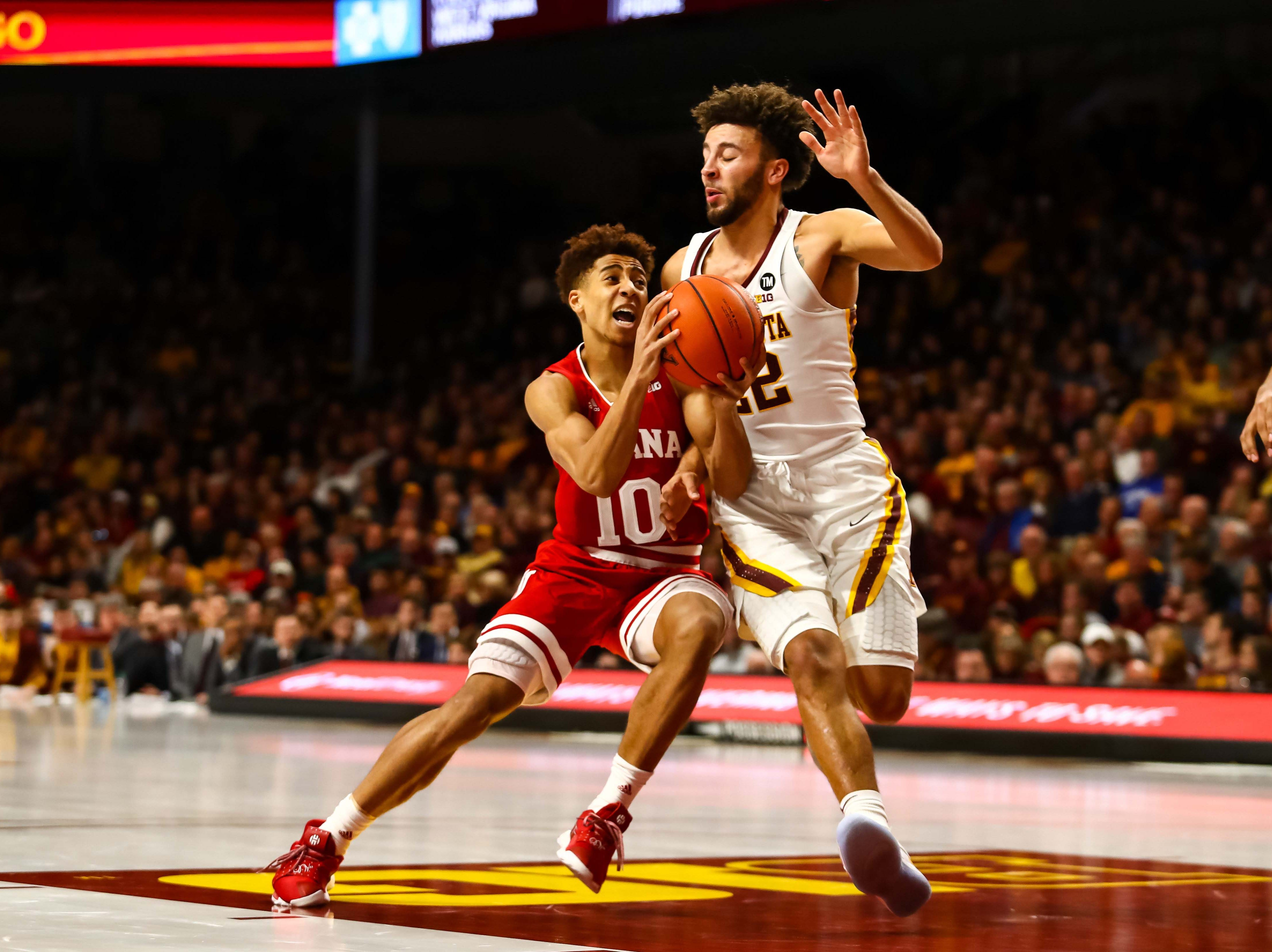 Feb 16, 2019; Minneapolis, MN, USA; Indiana Hoosiers guard Rob Phinisee (10) drives to the basket while Minnesota Golden Gophers guard Gabe Kalscheur (22) defends in the second half at Williams Arena. The Minnesota Golden Gophers defeatd the Indiana Hoosiers 84-63. Mandatory Credit: David Berding-USA TODAY Sports