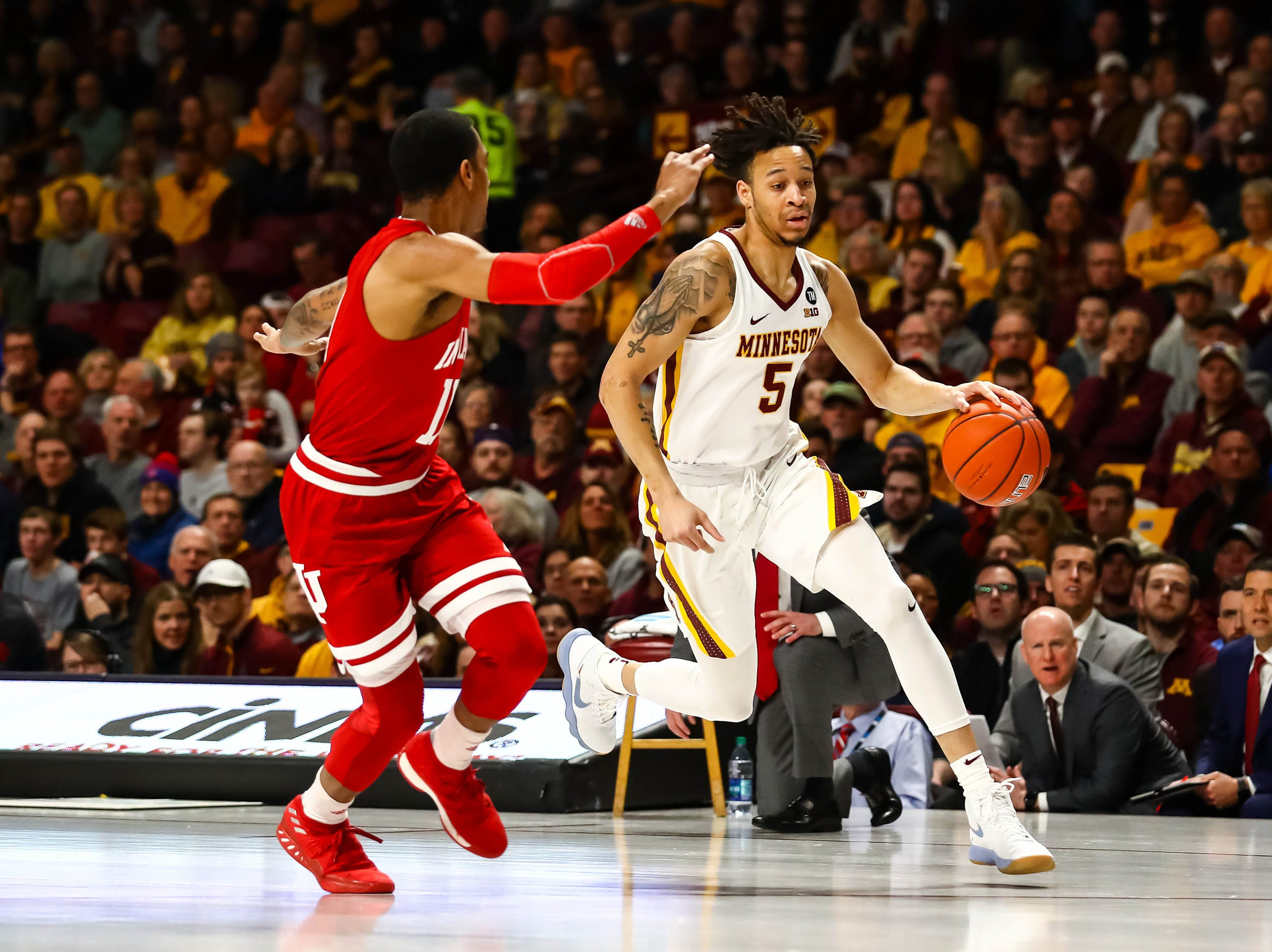 Minnesota Golden Gophers guard Amir Coffey (5) dribbles the ball while Indiana Hoosiers guard Devonte Green (11) defends in the first half at Williams Arena.