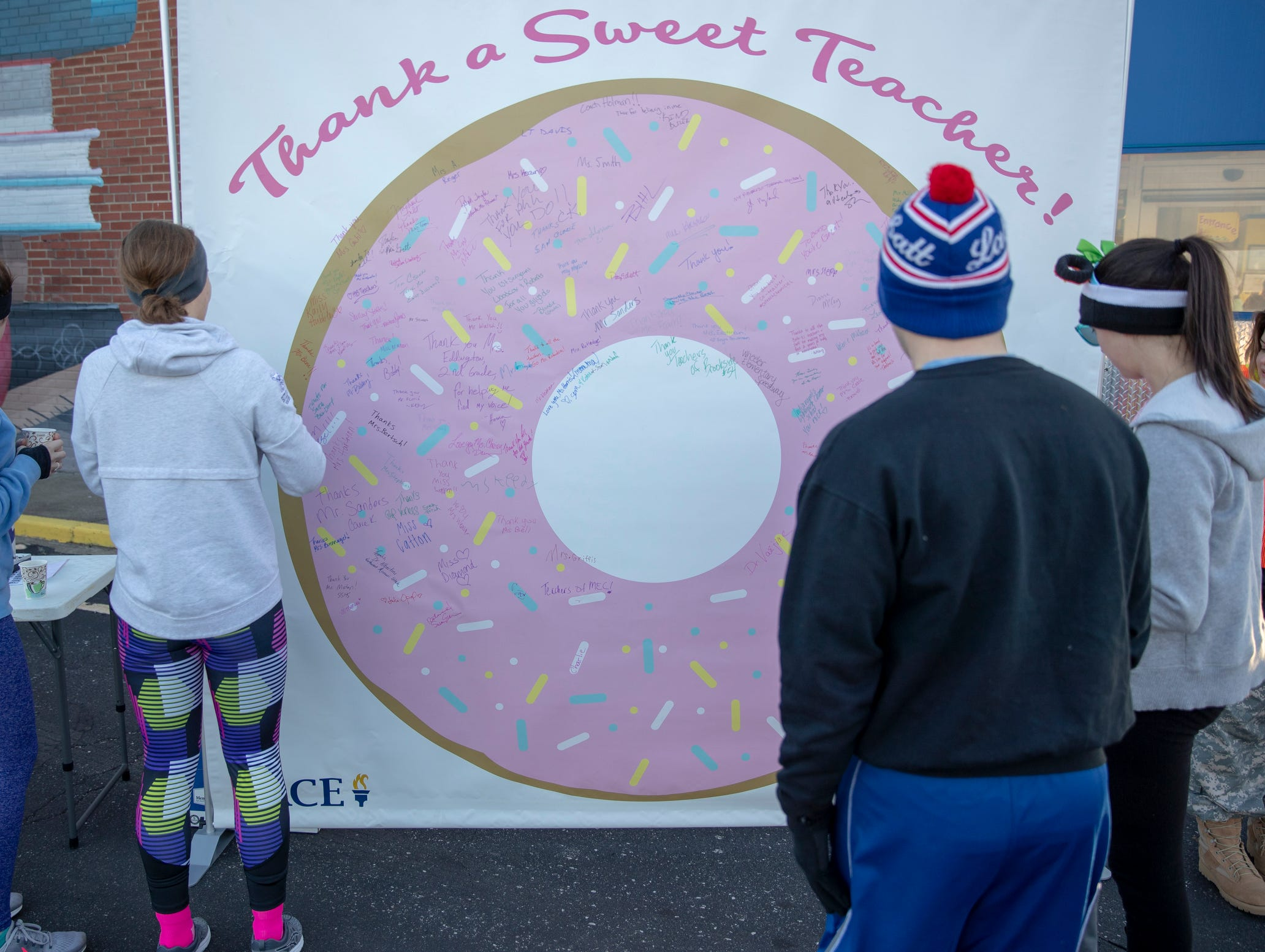 A 'thank you' wall for teachers at the Circle City Donut Dash 5k, a five kilometer race that benefits Teachers' Treasures, Indianapolis, Saturday, Feb. 16, 2019. The race invites willing runners to eat a dozen doughnut holes at the halfway point in the event that helps provide school supplies for area school kids.