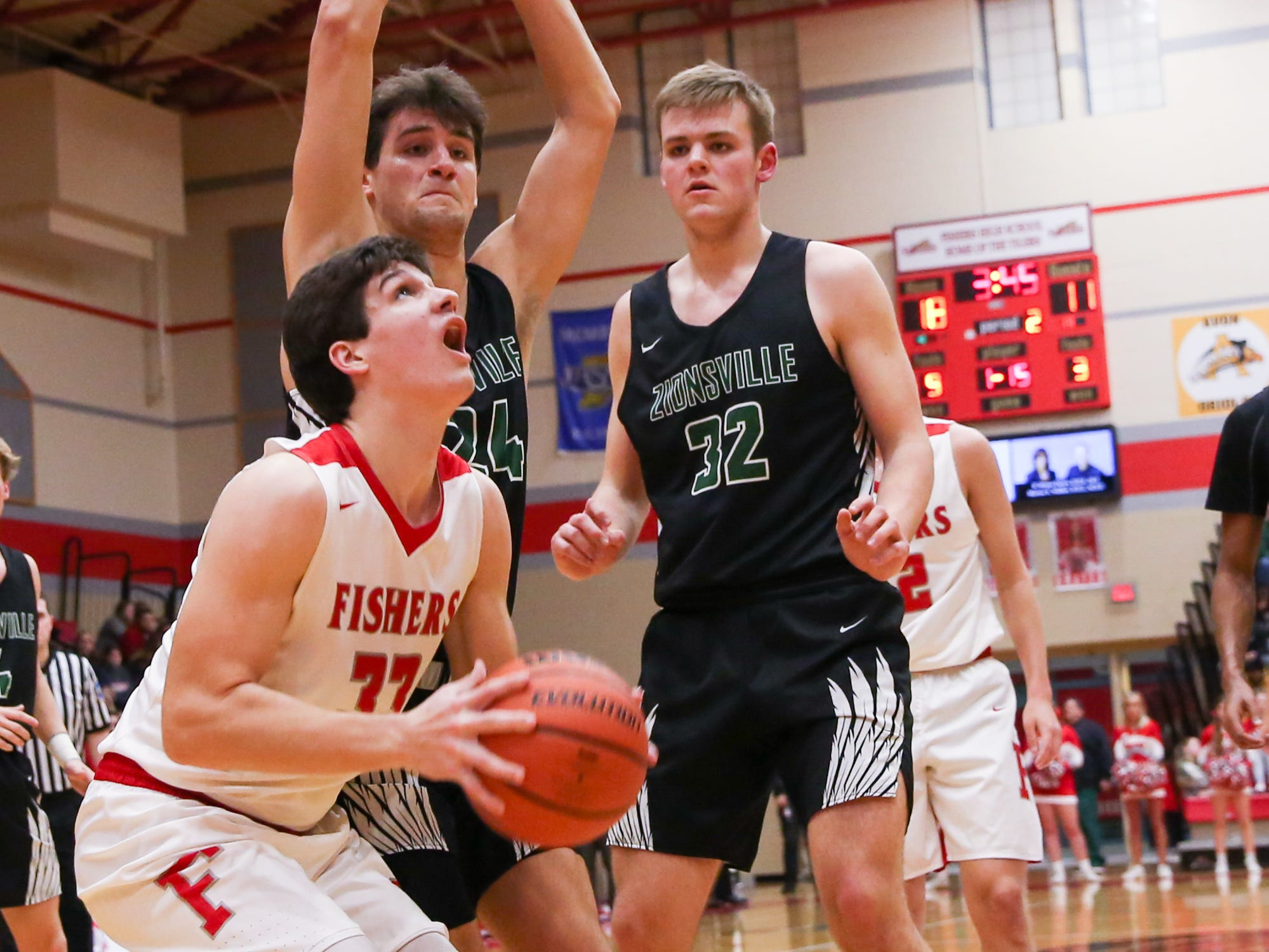 Fisher's Jeffrey Simmons (33) attempts a lay up during the first half of Zionsville vs. Fishers high school boys varsity basketball game held at Fishers High School, February 15, 2019.