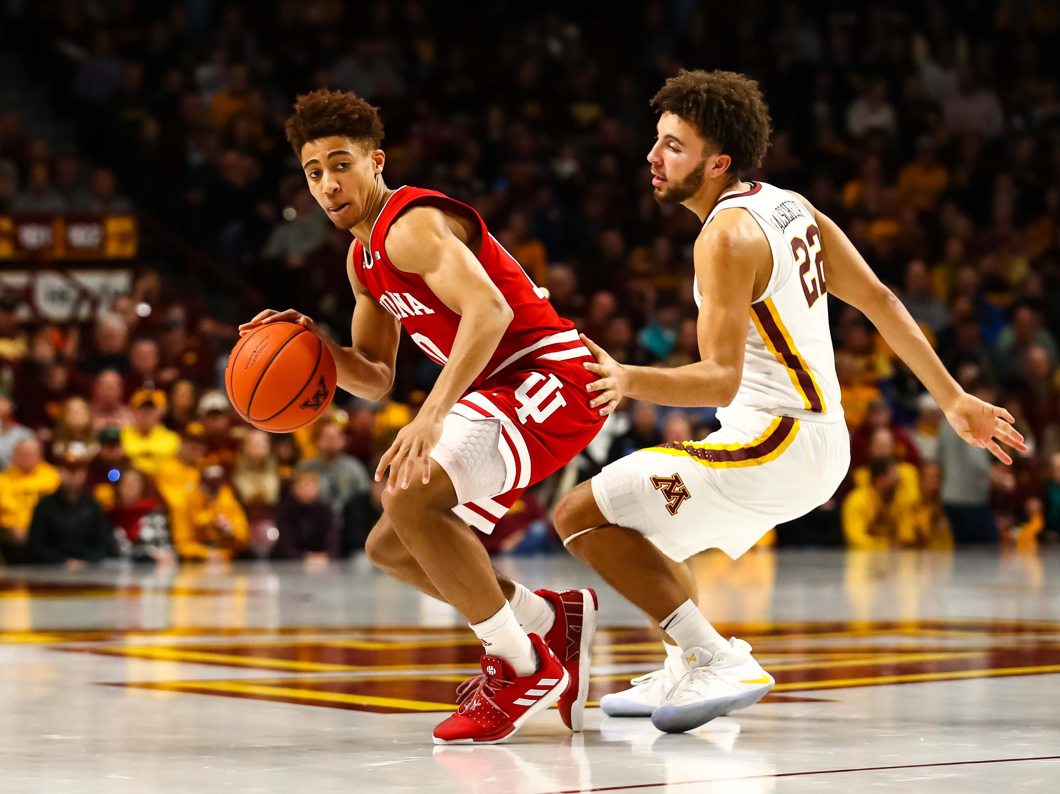 Feb 16, 2019; Minneapolis, MN, USA; Indiana Hoosiers guard Rob Phinisee (10) dribbles the ball while Minnesota Golden Gophers guard Gabe Kalscheur (22) defends in the second half at Williams Arena. The Minnesota Golden Gophers defeatd the Indiana Hoosiers 84-63. Mandatory Credit: David Berding-USA TODAY Sports