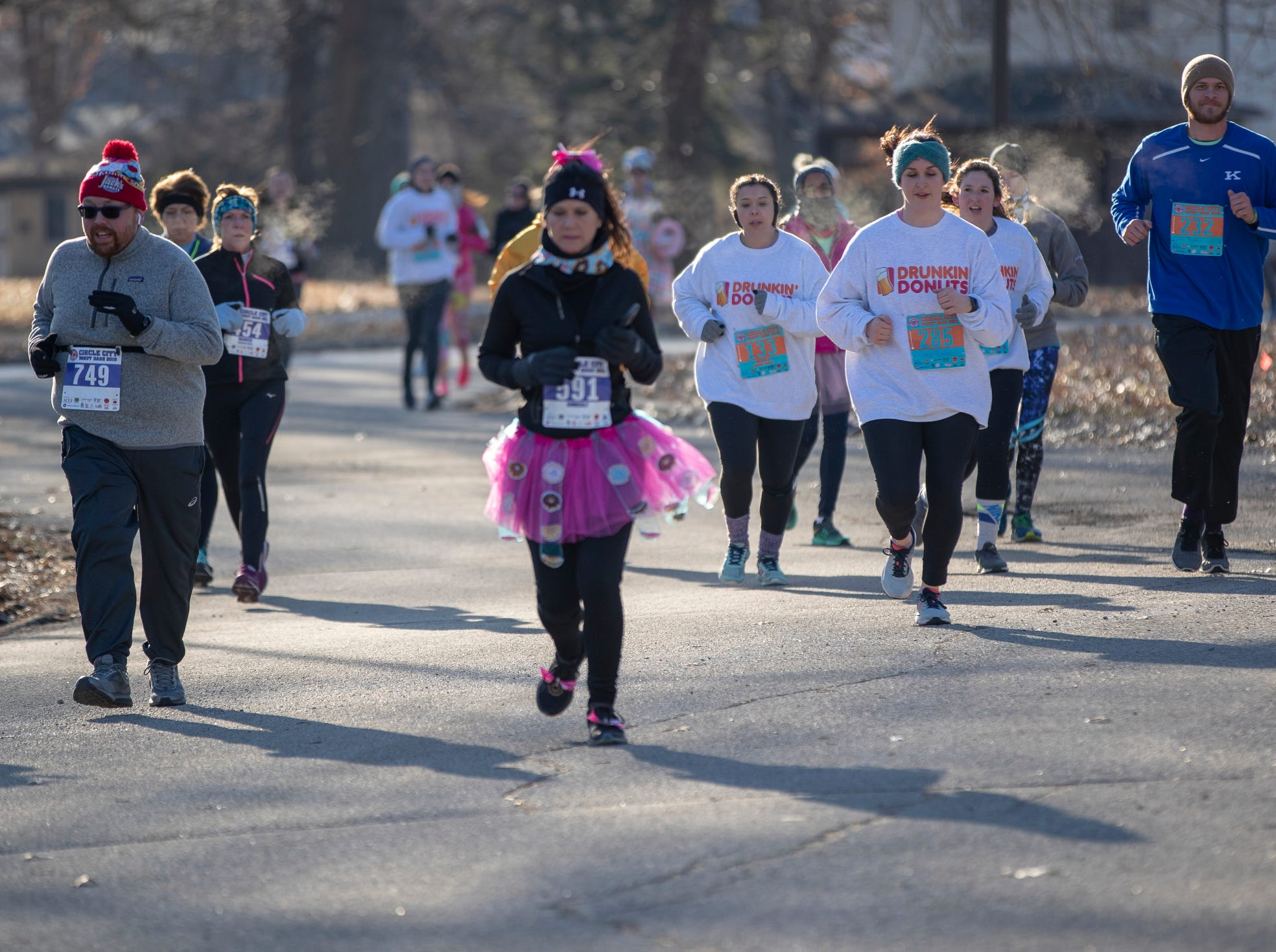 Entrants in the Circle City Donut Dash 5k, a five kilometer race that benefits Teachers' Treasures, Indianapolis, Saturday, Feb. 16, 2019. The race invites willing runners to eat a dozen doughnut holes at the halfway point in the event that helps provide school supplies for area school kids.