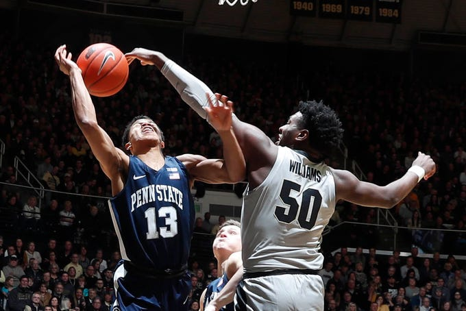 Purdue Boilermakers forward Trevion Williams (50) blocks the shot taken by Penn State Nittany Lions guard Rasir Bolton (13) during the first half at Mackey Arena.