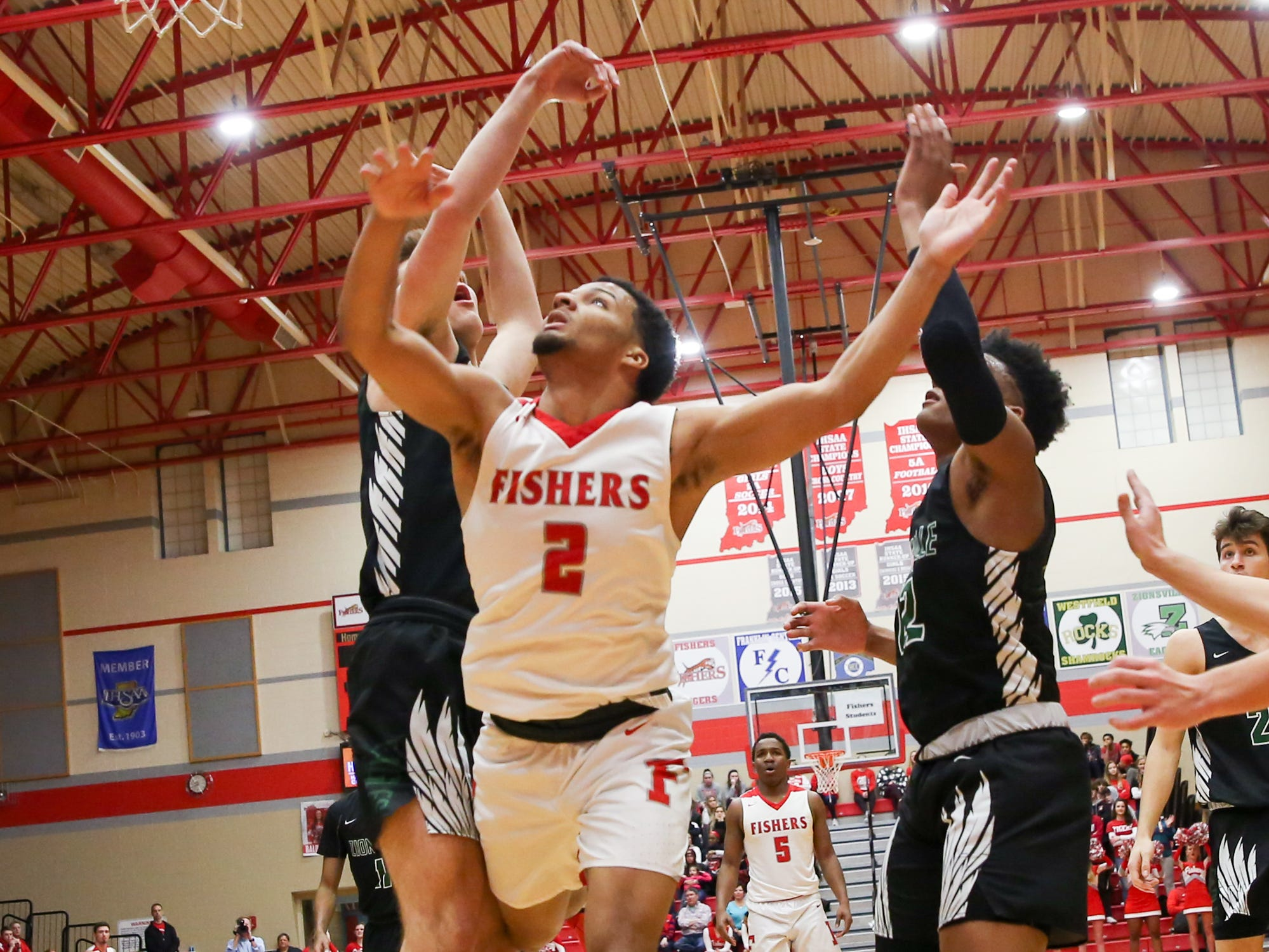Fisher's Josiah Matthews (2) drives in for a lay up during the first half of Zionsville vs. Fishers high school boys varsity basketball game held at Fishers High School, February 15, 2019.