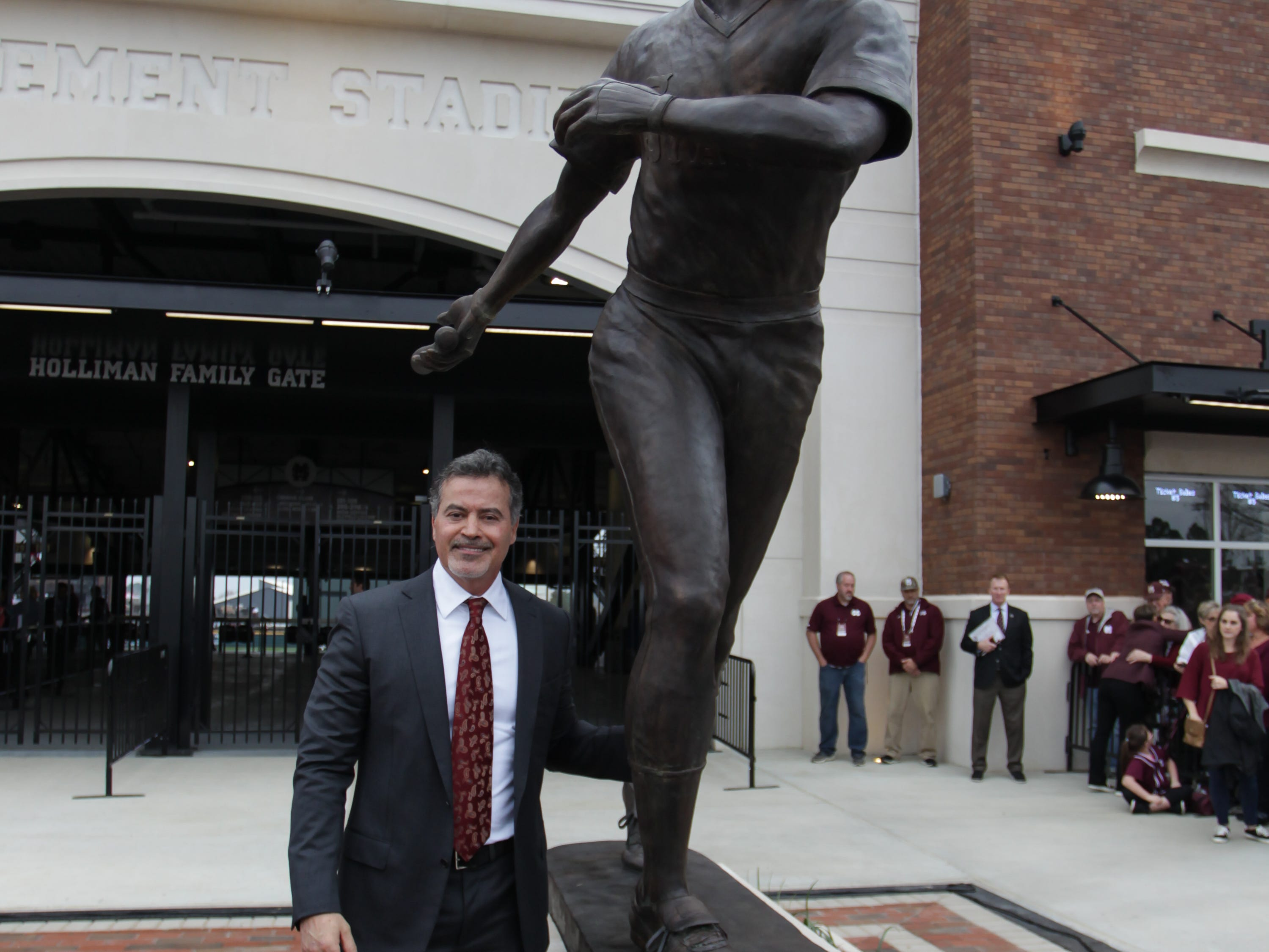 Rafael Palmeiro stands beside a statue commorating his playing days at MSU. Mississippi State opened the 2019 baseball season against Youngstown State on Friday, February 15, 2019. Photo by Keith Warren
