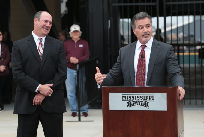 Former MSU baseball player Rafael Palmeiro  speaks prior to the opening of the renovated Dudy Noble Field. His former teammate Will Clark listens in the background. Mississippi State opened the 2019 baseball season against Youngstown State on Friday, February 15, 2019. Photo by Keith Warren