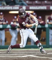 Mississippi State's Jake Mangum (15) makes contact with the ball. Mississippi State opened the 2019 baseball season against Youngstown State on Friday, February 15, 2019. Photo by Keith Warren