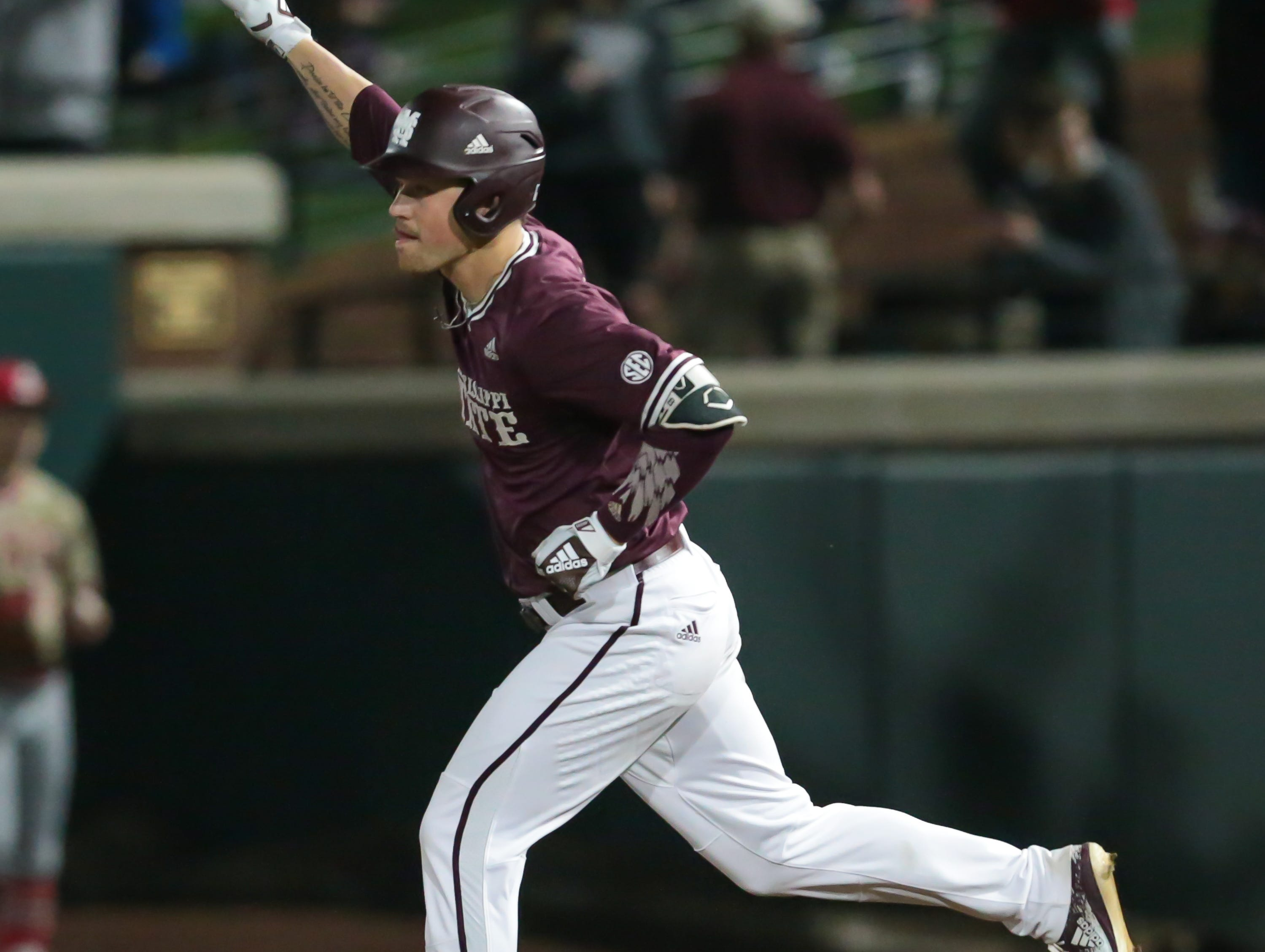 Mississippi State's Elijah MacNamee (40) celebrates after hitting a home run. Mississippi State opened the 2019 baseball season against Youngstown State on Friday, February 15, 2019. Photo by Keith Warren