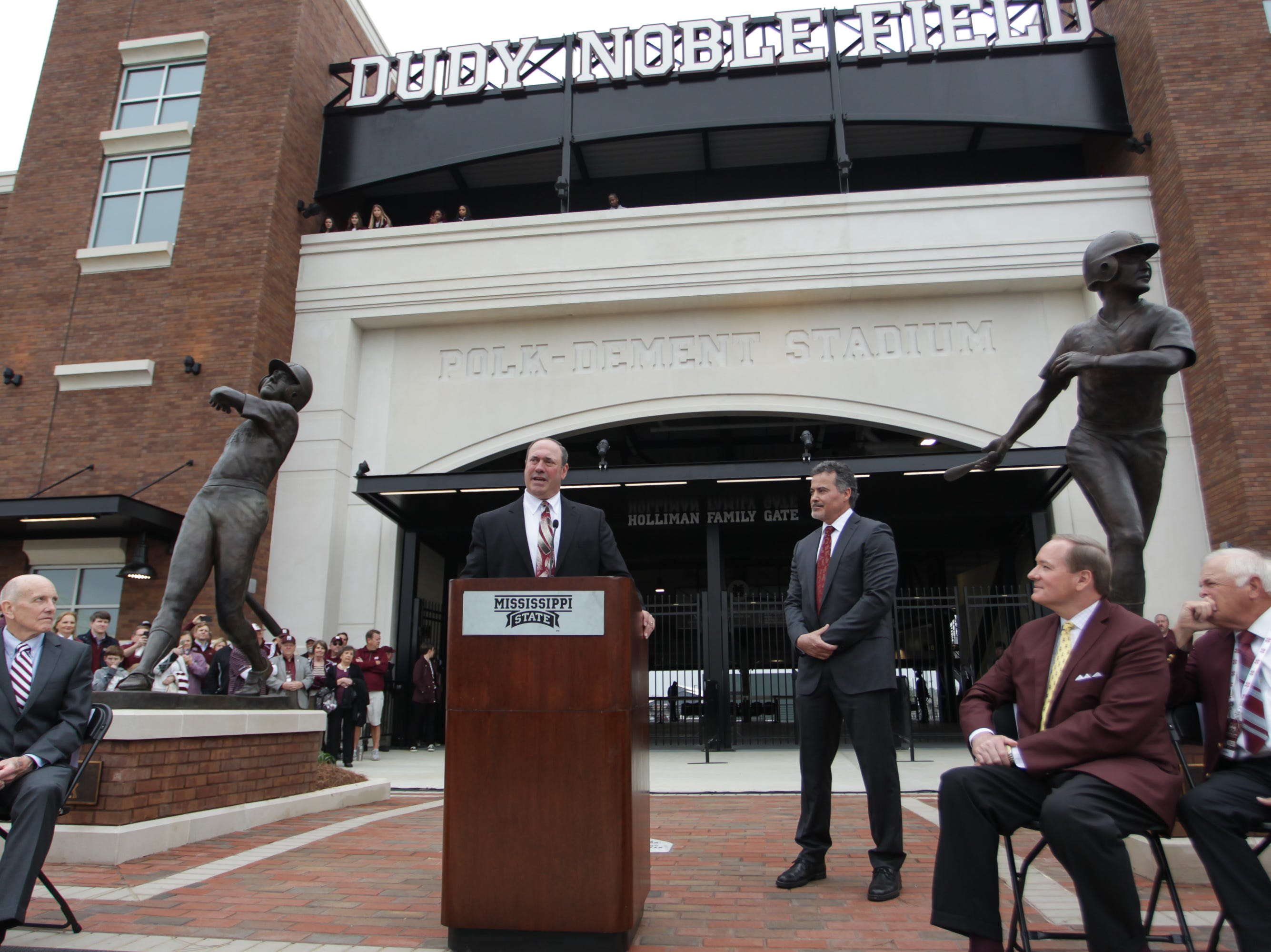 will Clark speaks as Rafael Palmeiro listens during a ceremony opening the renovated Dudy Noble Field. Mississippi State opened the 2019 baseball season against Youngstown State on Friday, February 15, 2019. Photo by Keith Warren