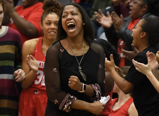 Bianca Hensley celebrates a Region 14-AA tournament semifinal win over her alma mater, Chester County, during a recent game. Hensley has been hired as Stewarts Creek's girls basketball coach.