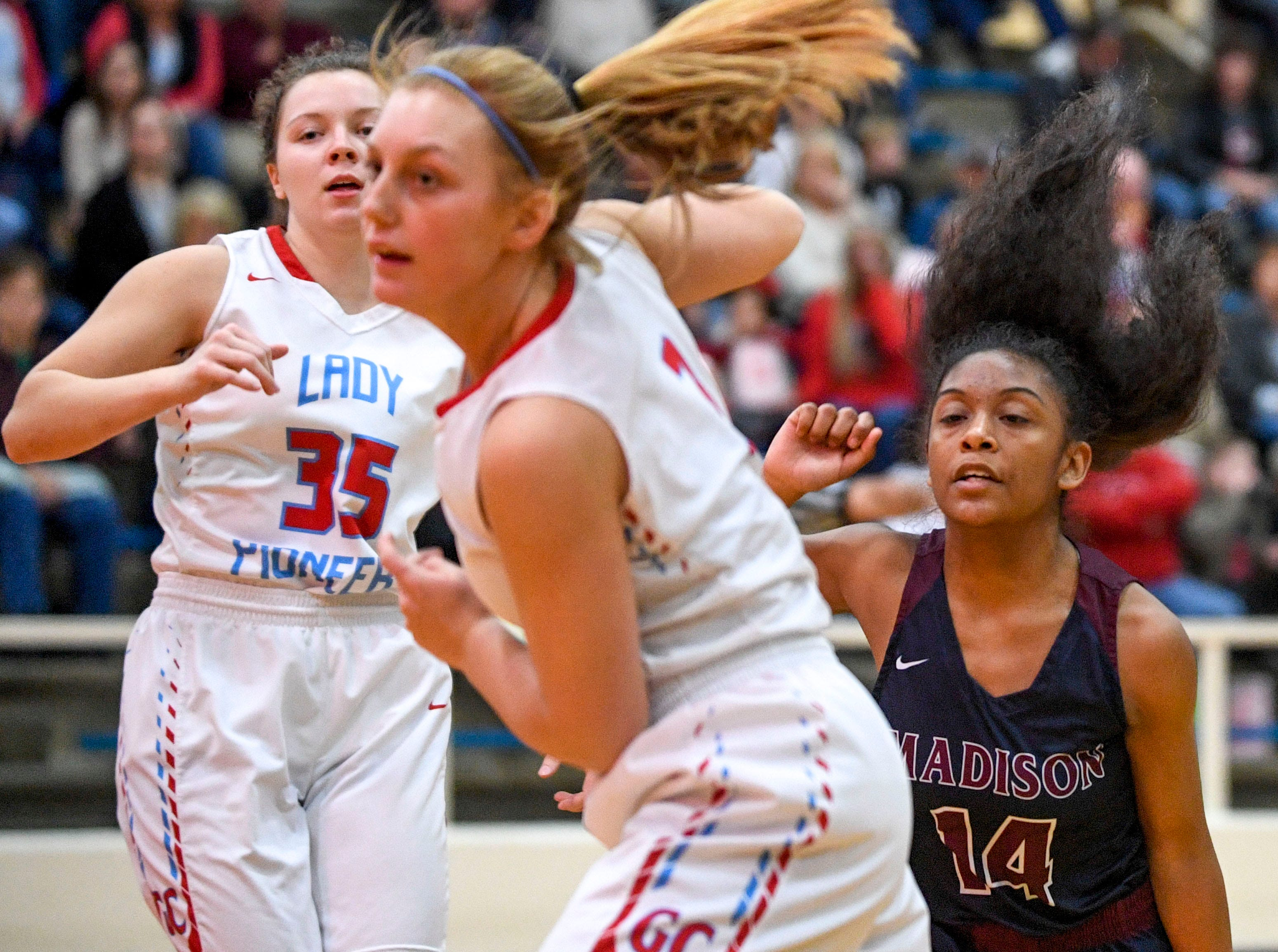 Gibson County's Macey Neal (3) and Hannah Ball (35) look up after Madison Academic's Carmen Echols (14) passes the ball to a teammate during the TSSAA girls 14-A semifinals basketball game between Gibson County and Madison Academic at Gibson County High School in Dyer, Tenn., on Friday, Feb. 15, 2019.