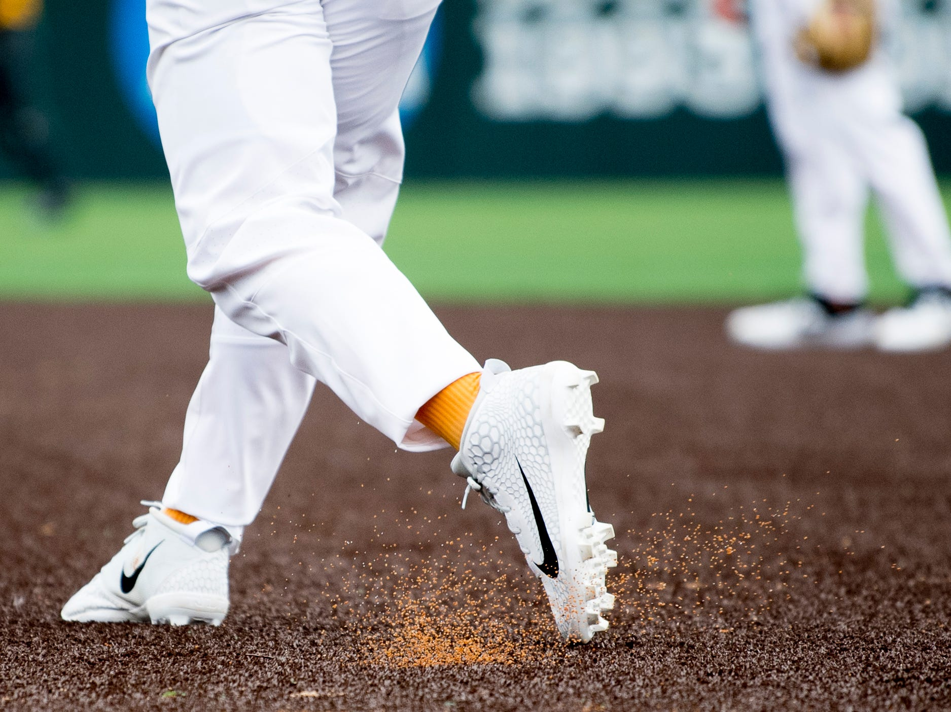 A Tennessee player kicks up turf pieces on the all-new turf field at Lindsey Nelson Stadium in Knoxville, Tennessee on Saturday, February 16, 2019. The pitchers mound is the only part of the field that remains dirt.