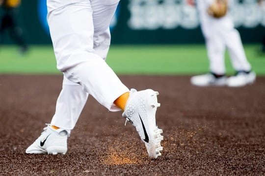 A Tennessee player kicks up infill pieces on the new turf field at Lindsey Nelson Stadium. The pitcher's mound is the only part of the field that remains dirt.