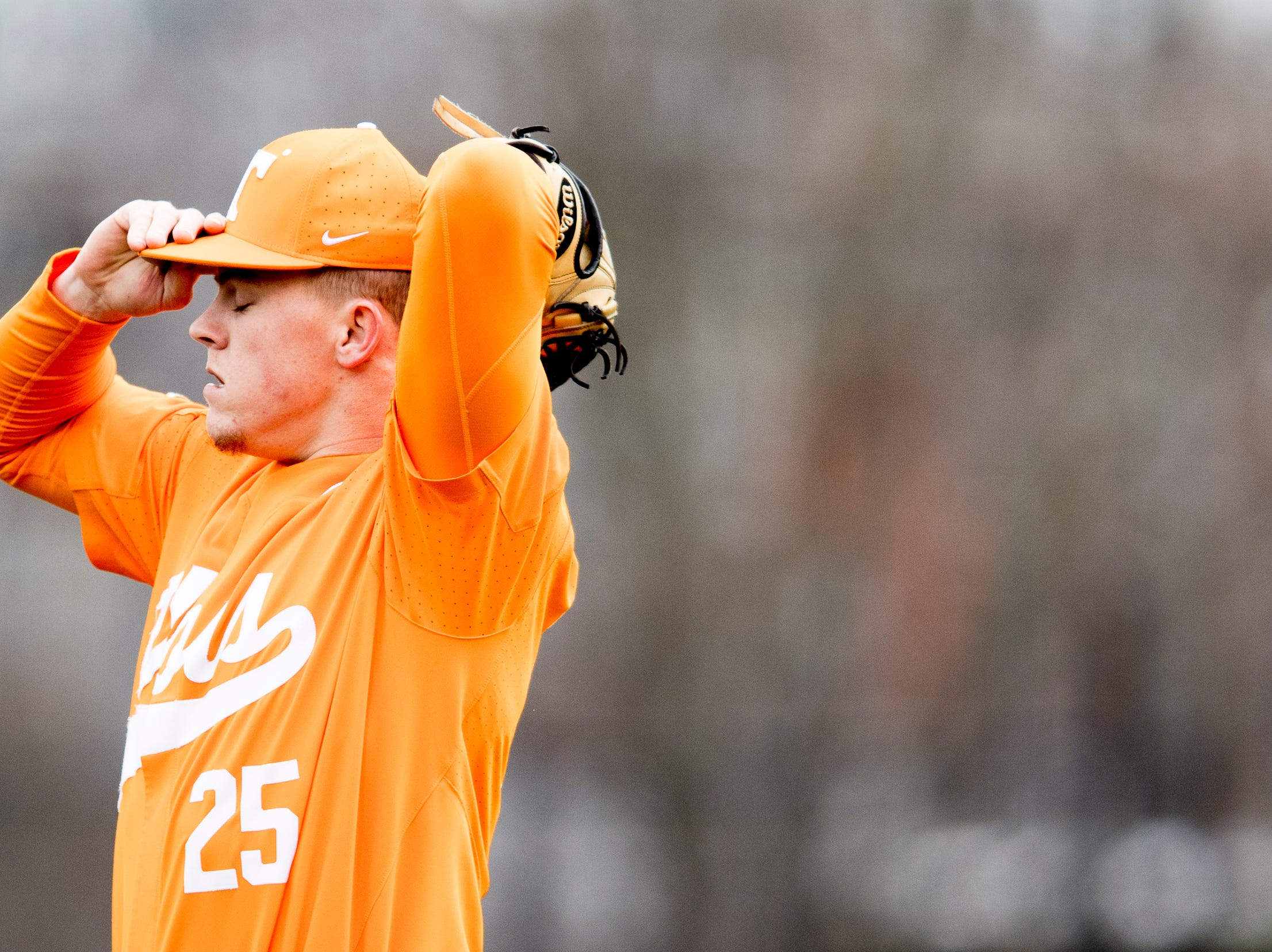 Tennessee pitcher Zach Linginfelter (25) prepares to pitch during a Tennessee baseball home opener game against Appalachian State at Lindsey Nelson Stadium in Knoxville, Tennessee on Saturday, February 16, 2019.