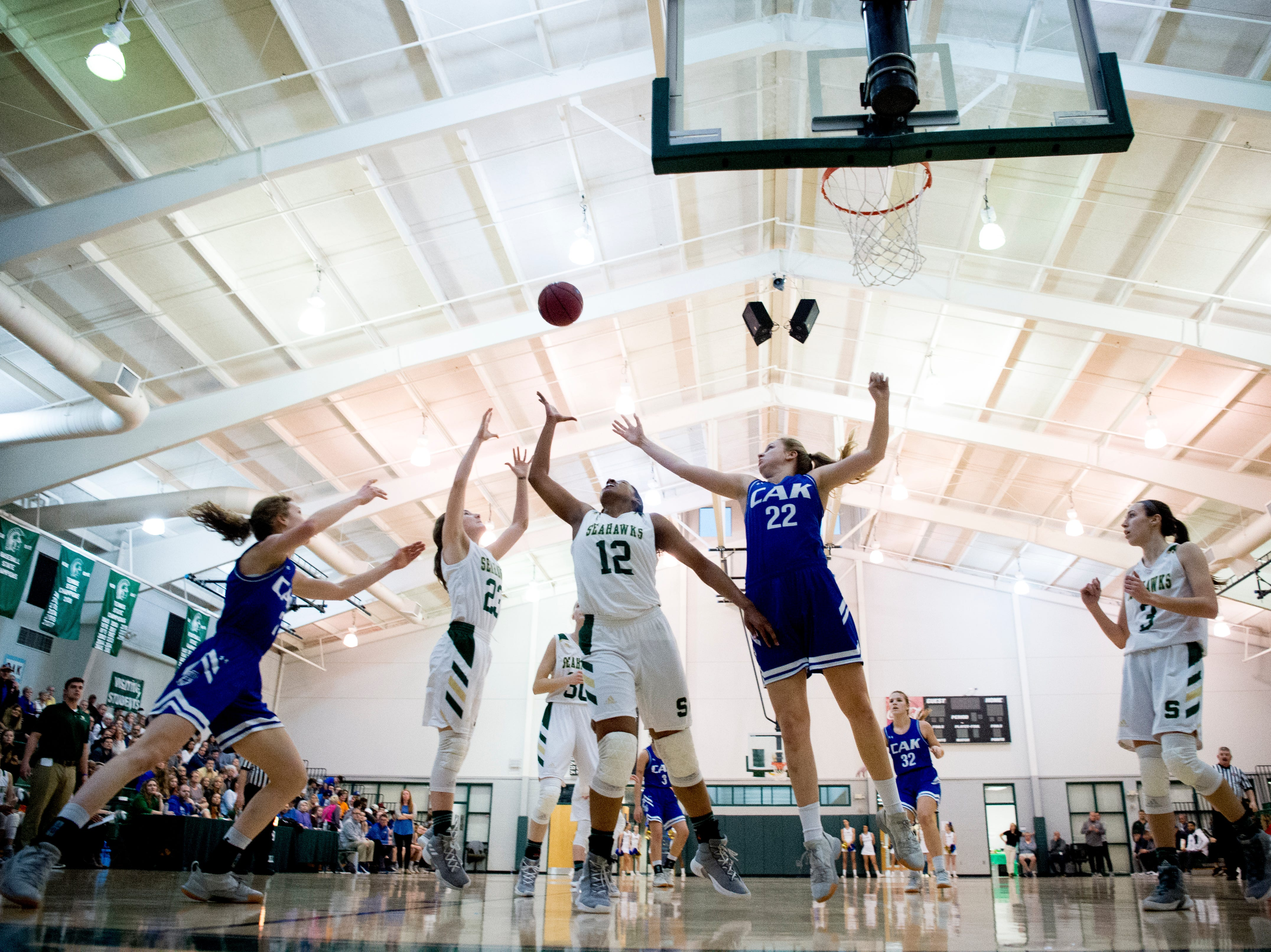 CAK's Caroline Meyers (22) and Silverdale's Laney Bone (12) reach for the ball during a semifinal game between CAK and Silverdale at Webb School of Knoxville in Knoxville, Tennessee on Friday, February 15, 2019.