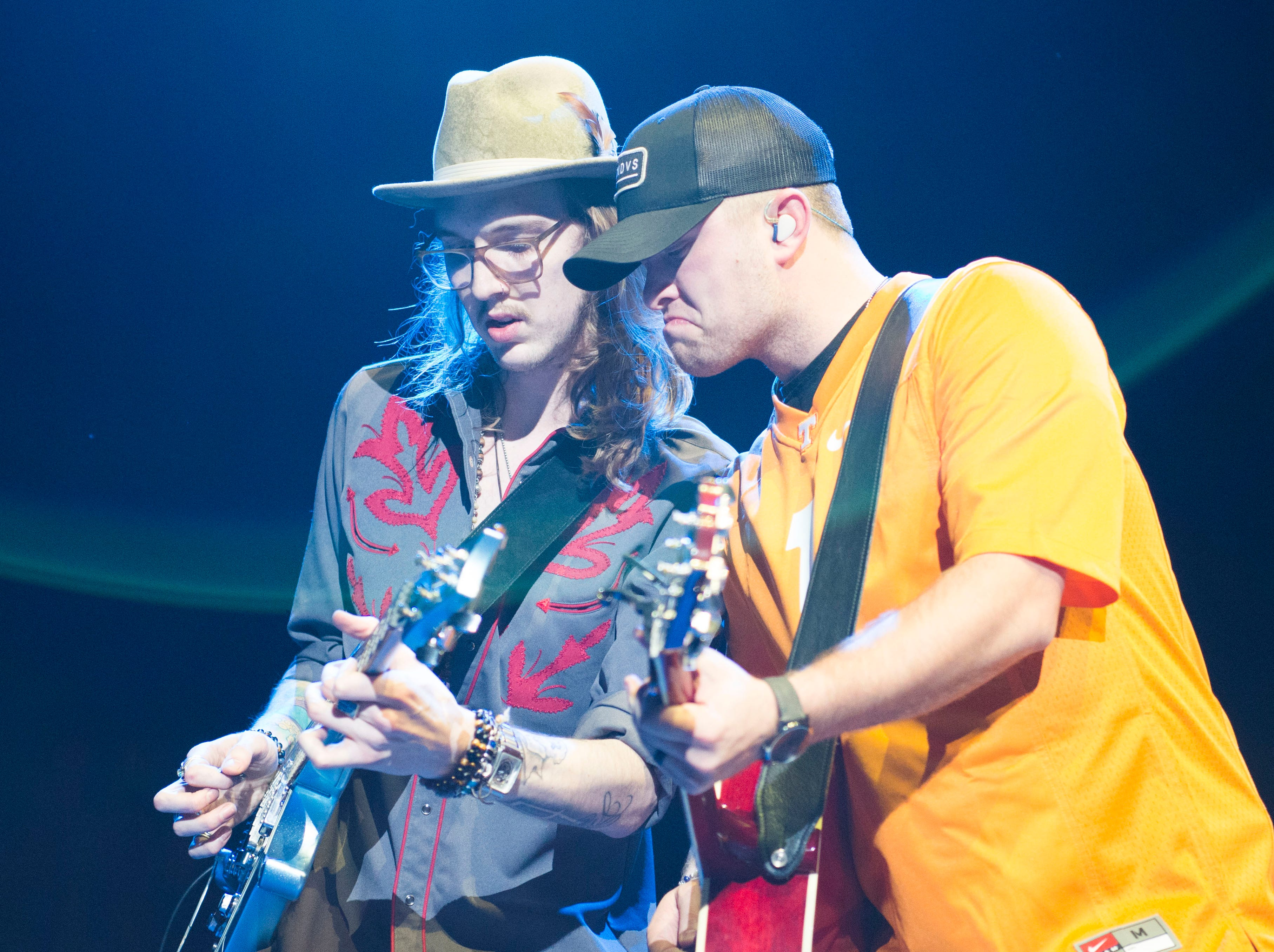 A guitarist and Jordan Walker of Walker McGuire open for Luke Combs in Thompson-Boling Arena in Knoxville Friday, Feb. 15, 2019.