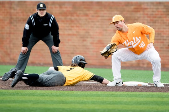 Tennessee infielder Luc Lipcius (40) attempts to out Appalachian State's Bailey Welch (3) at first during a Tennessee baseball home opener game against Appalachian State at Lindsey Nelson Stadium in Knoxville, Tennessee on Saturday, February 16, 2019.