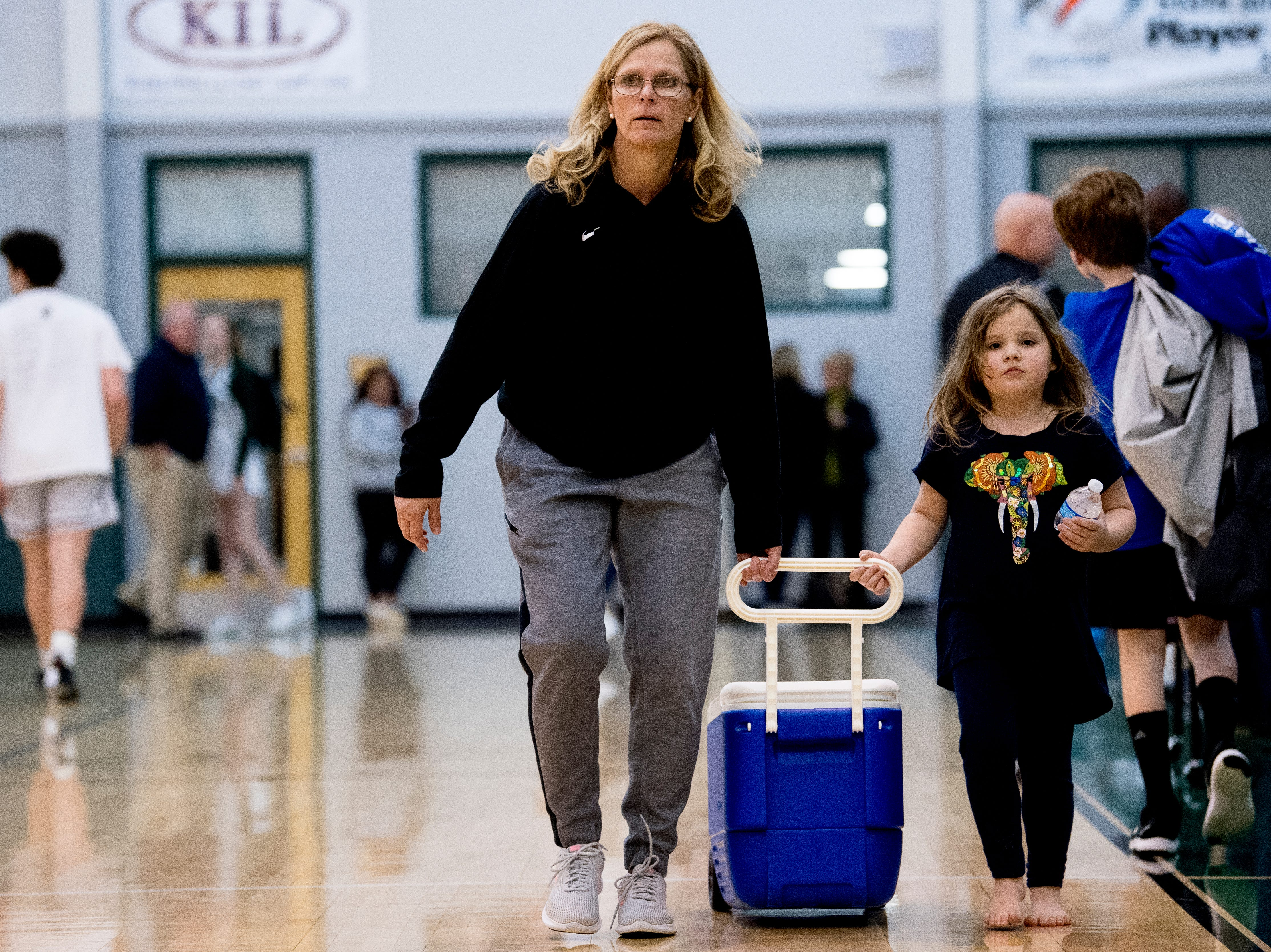 Webb girls head coach Shelley Collier gets some help pulling a cooler during a semifinal game tournament at Webb School of Knoxville in Knoxville, Tennessee on Friday, February 15, 2019.