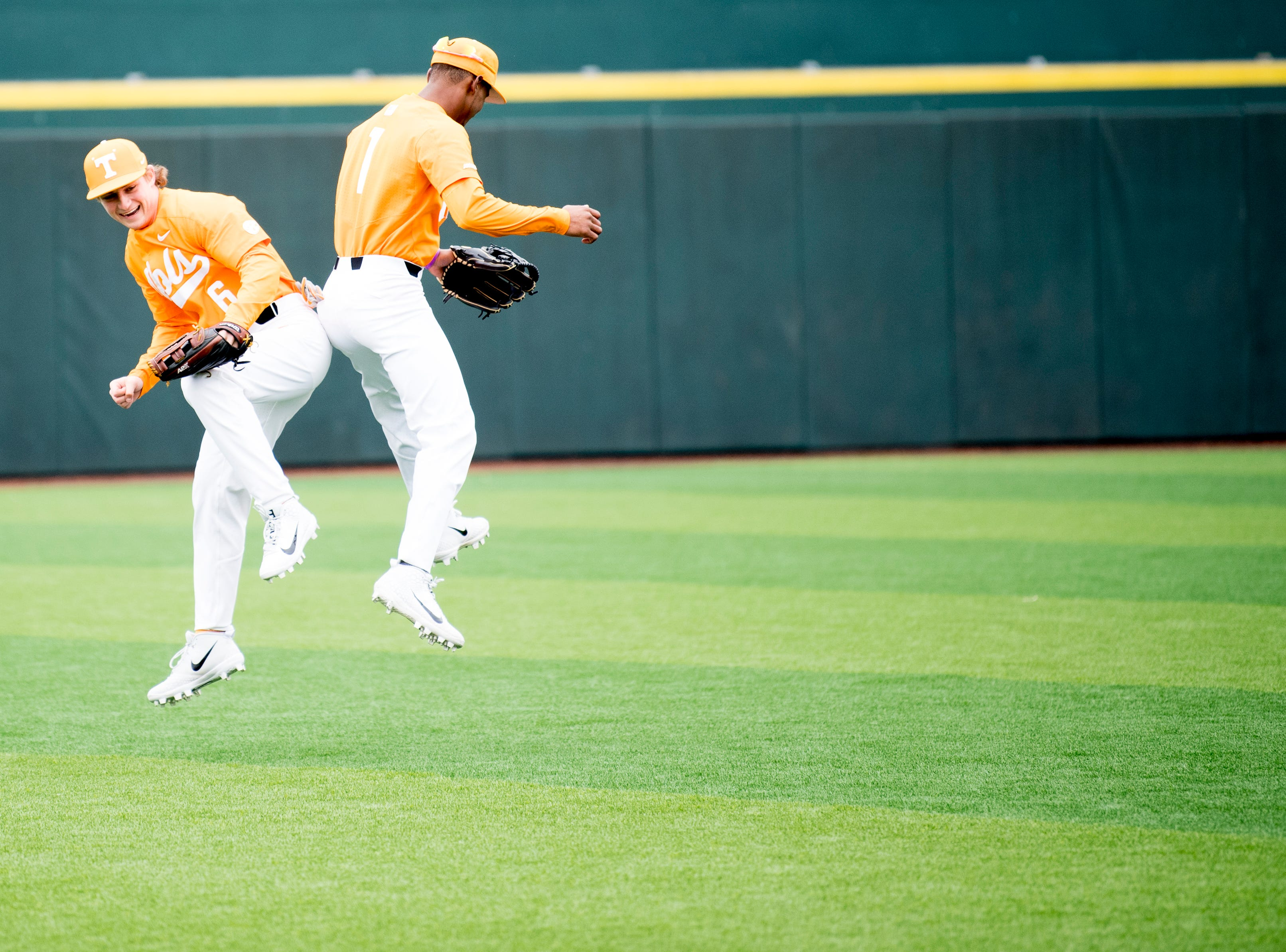 Tennessee outfielder/infielder Al Soularie (1) and Tennessee outfielder Evan Russell (6) celebrate together during a Tennessee baseball home opener game against Appalachian State at Lindsey Nelson Stadium in Knoxville, Tennessee on Saturday, February 16, 2019.